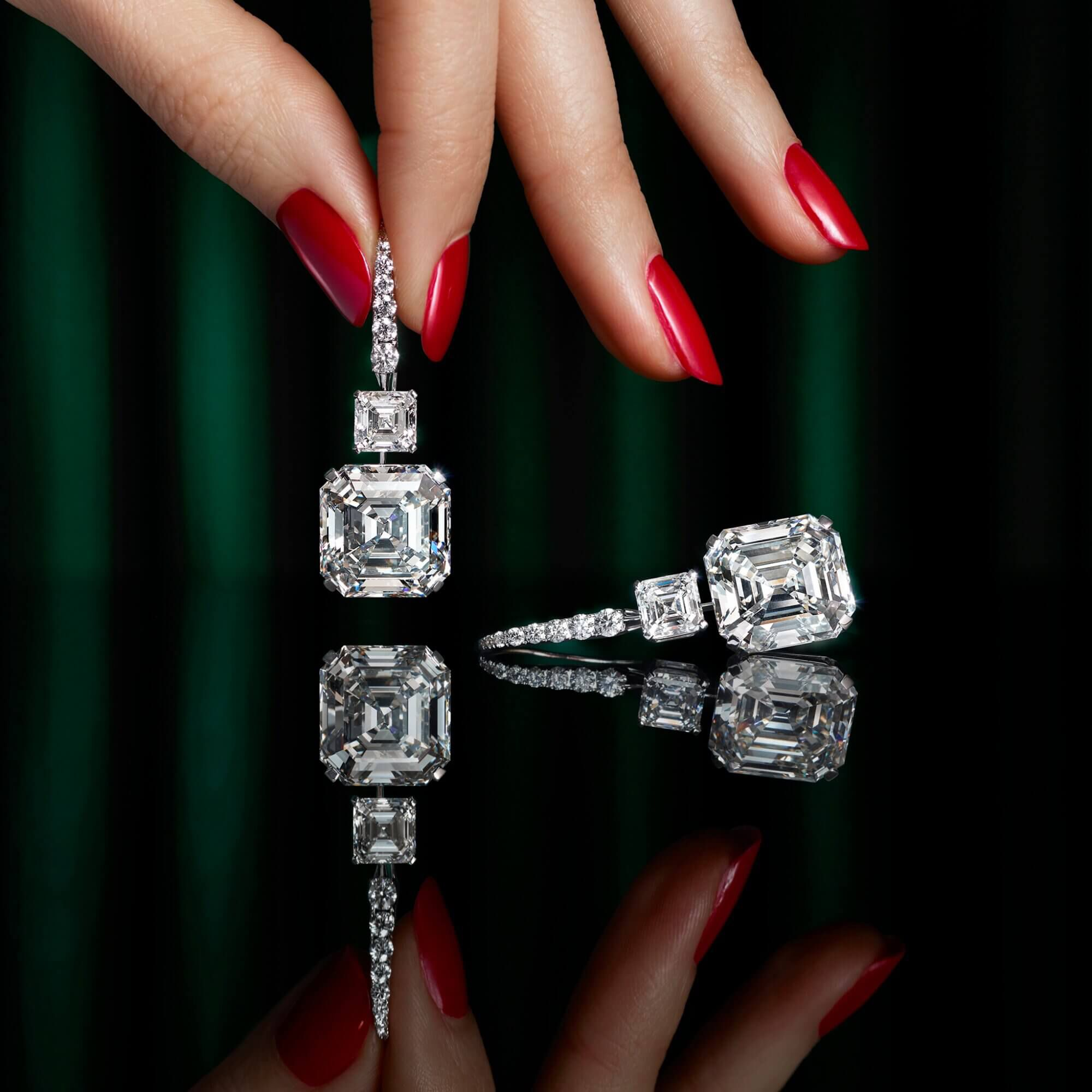 Model holding the Graff emerald cut diamond earrings with swan hooks from the Graff high jewellery collection