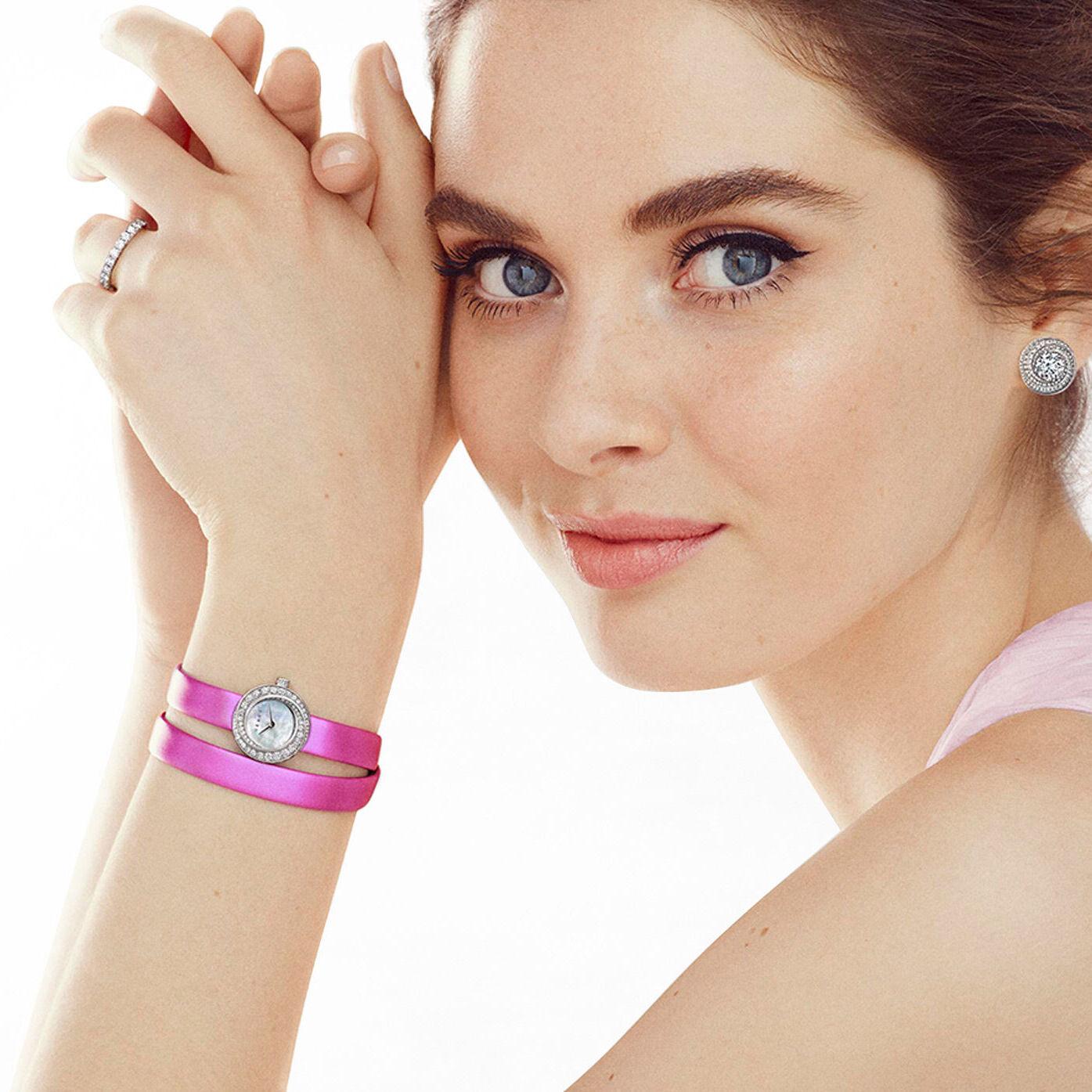 Model wears a Graff Spiral watch with a pink satin strap