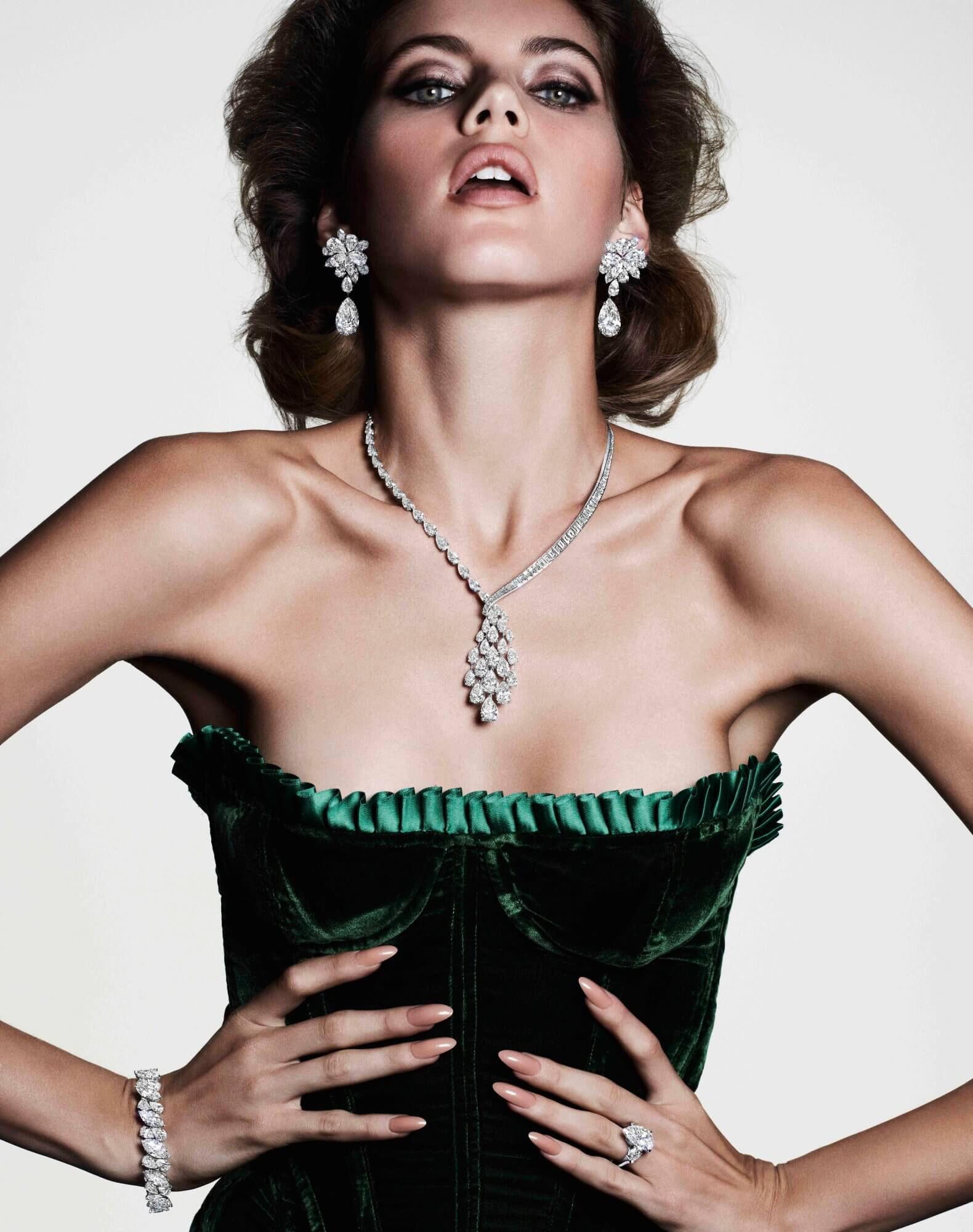 A model wearing Graff High Jewellery Diamond earrings, bracelet and necklace