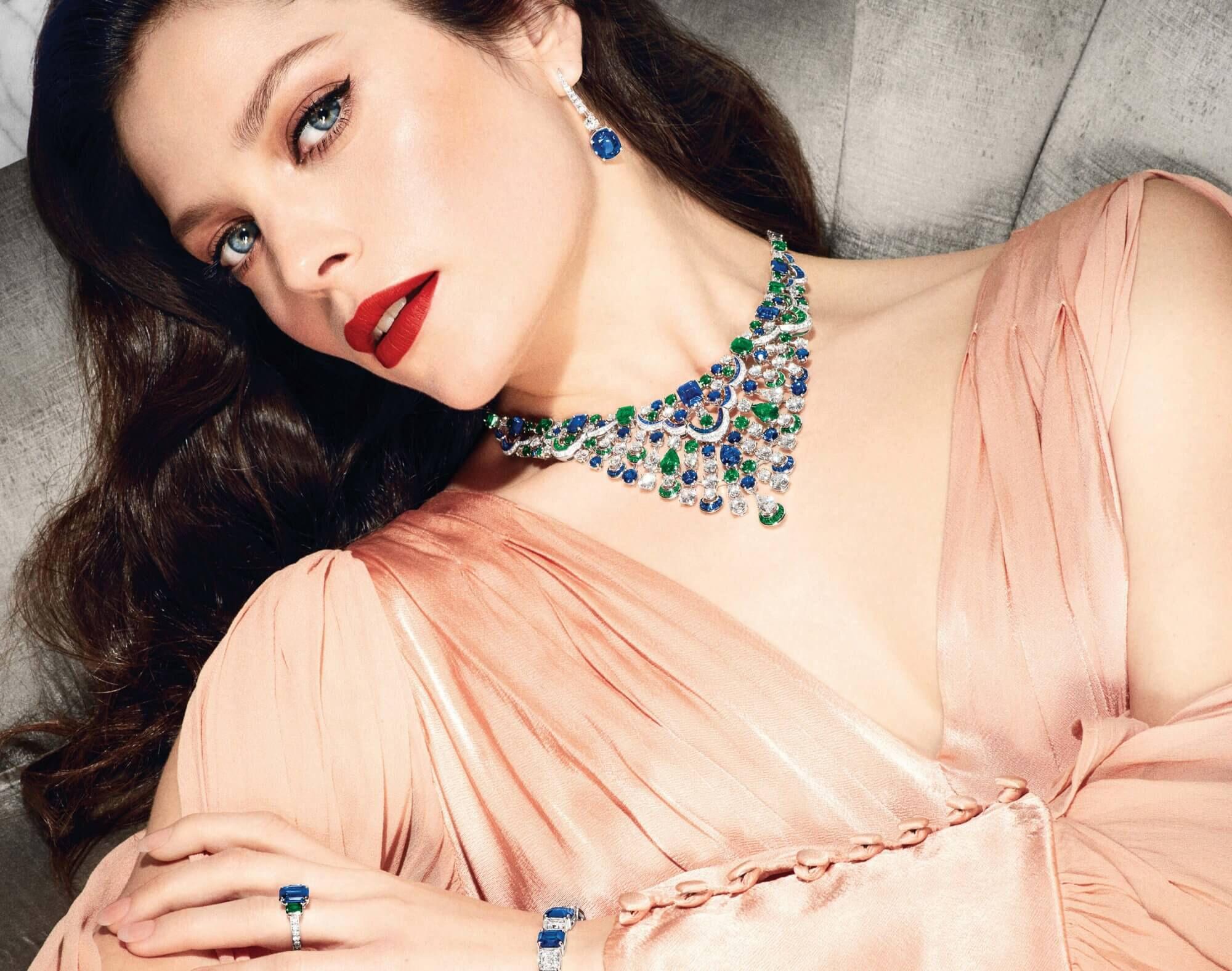 Model wears Graff Diamond earrings featuring a pair of 6cts Royal Blue cushion cut Sri Lankan sapphires.