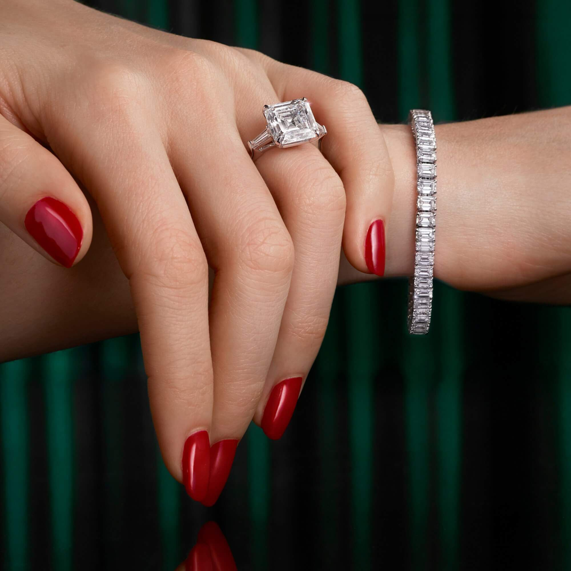 a lady wearing a graff emerald cut ring and bracelet from the Graff high jewellery collection