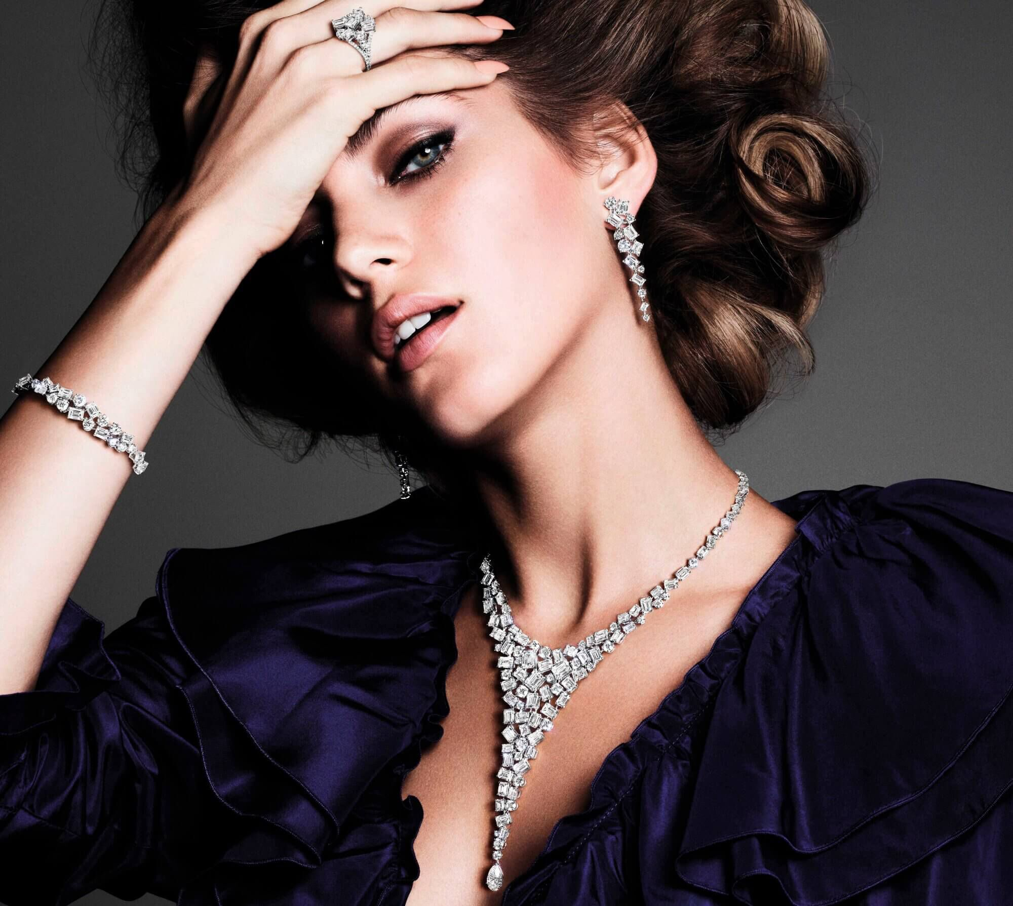 A model wearing Graff Abstract collection Diamond earrings ring bracelet and necklace