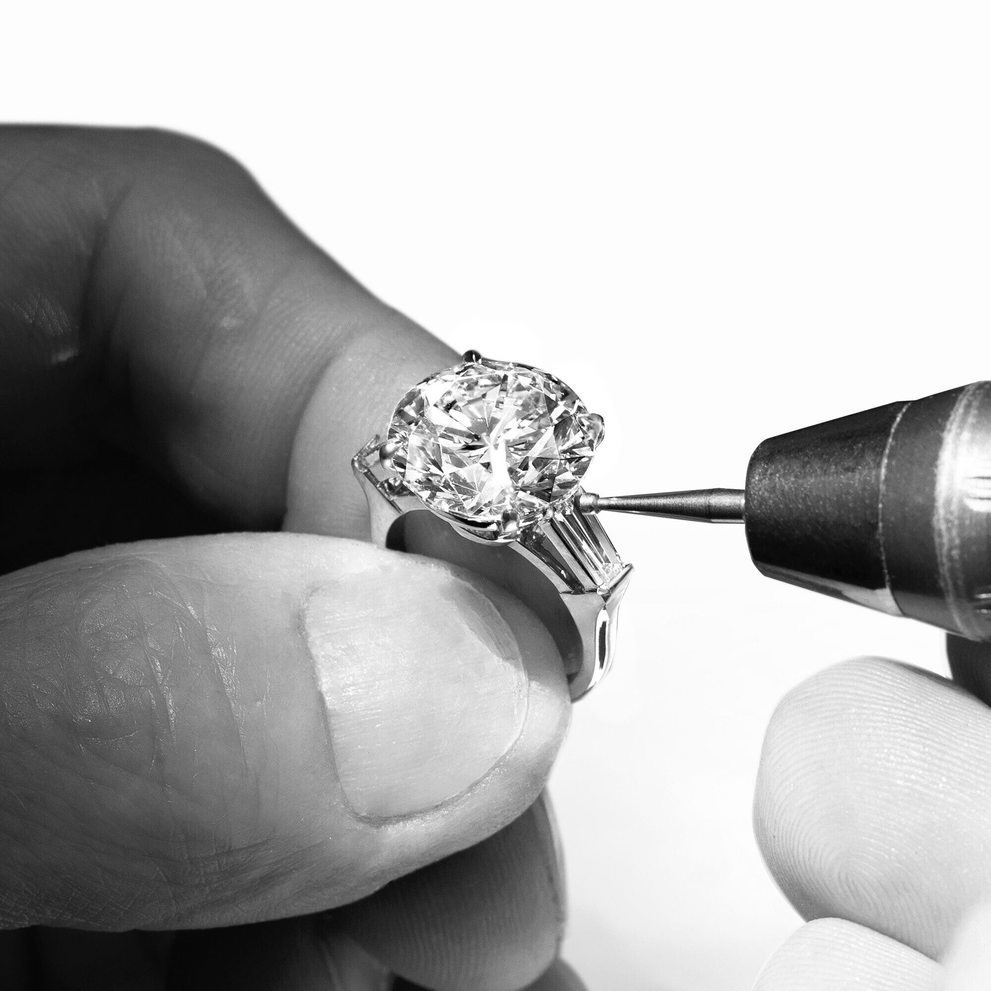 Close up of a Graff craftsman setting a diamond ring