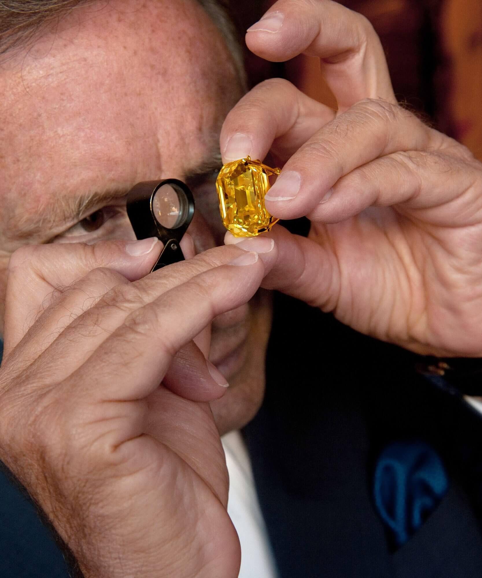 Laurence Graff inspecting a yellow diamond