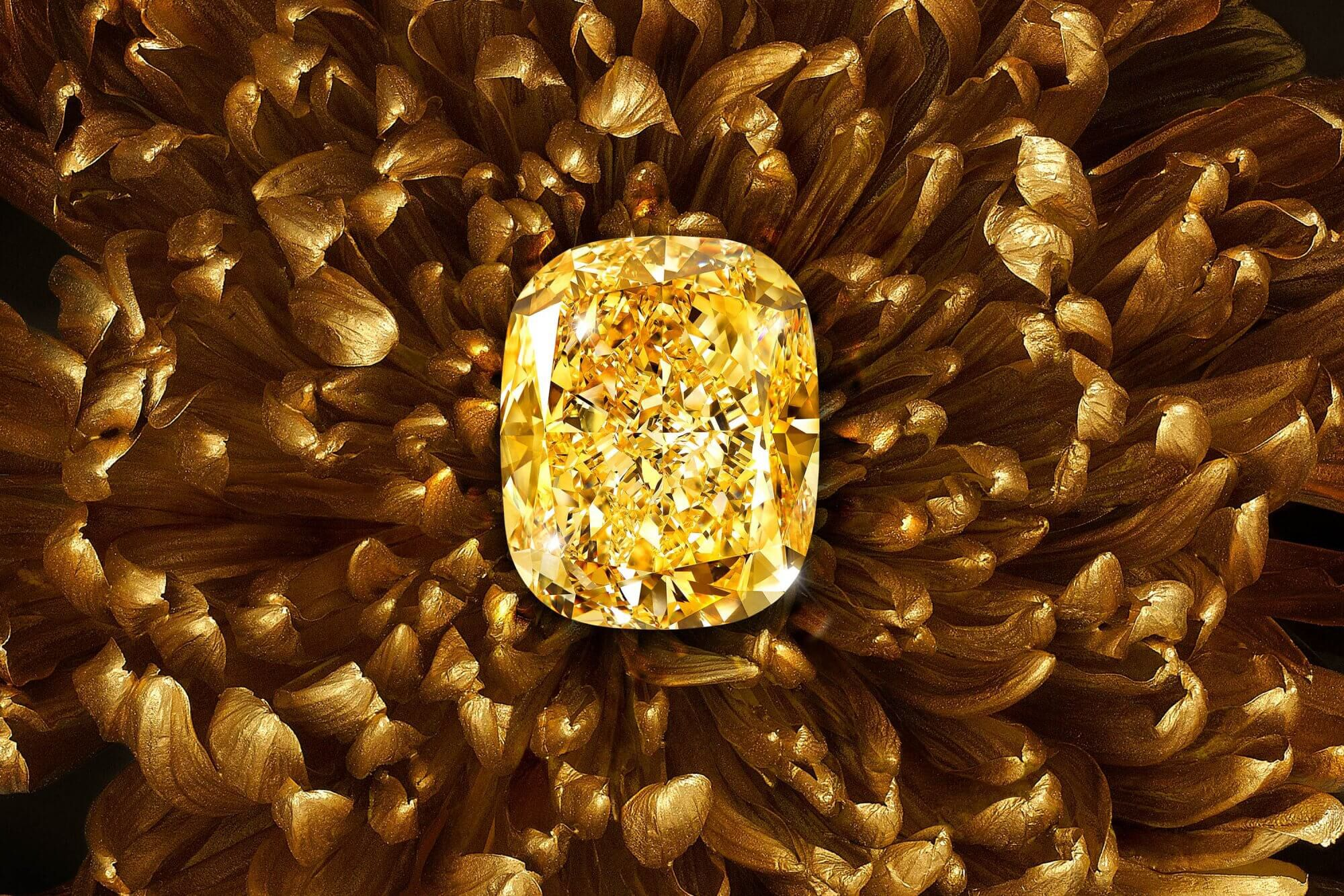 The famous Graff Golden Empress yellow diamond with a background of golden flower petals