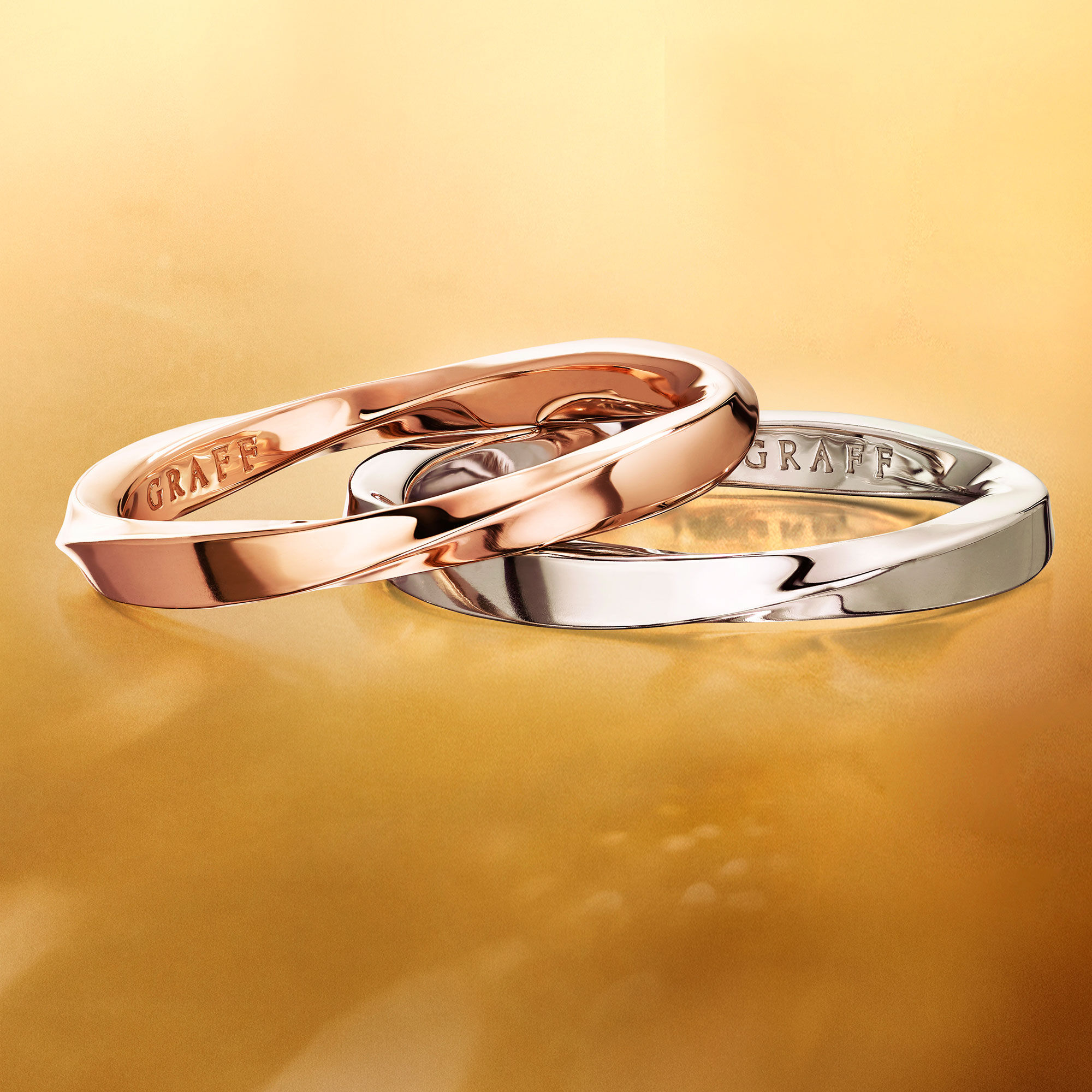 Graff Spiral jewellery collection band set in rose and white gold