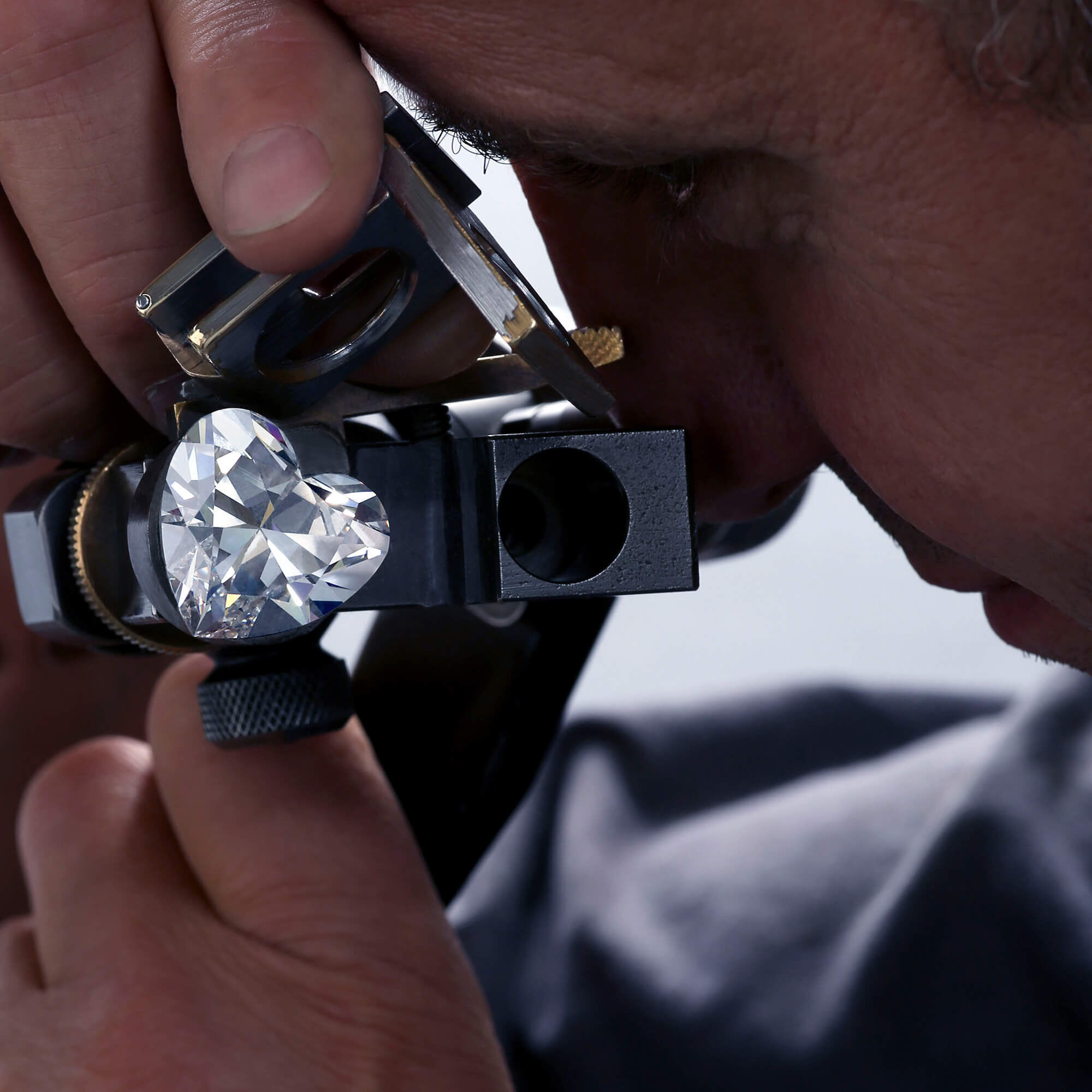 A Graff member looking into the Venus diamond through a loupe