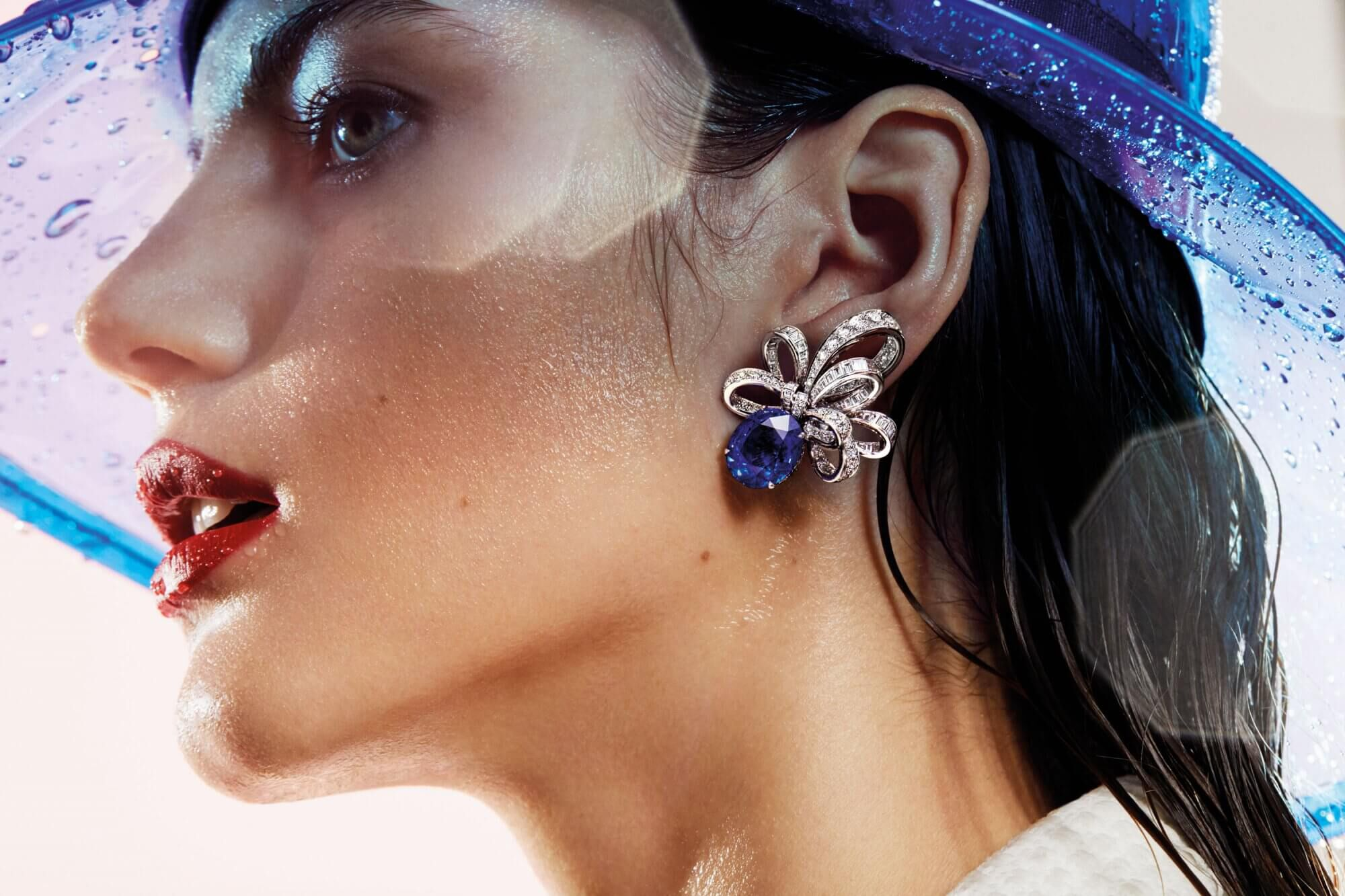 Close up of a model wearing a Graff Inspired by Twombly Collection Sapphire and Diamond Earring.