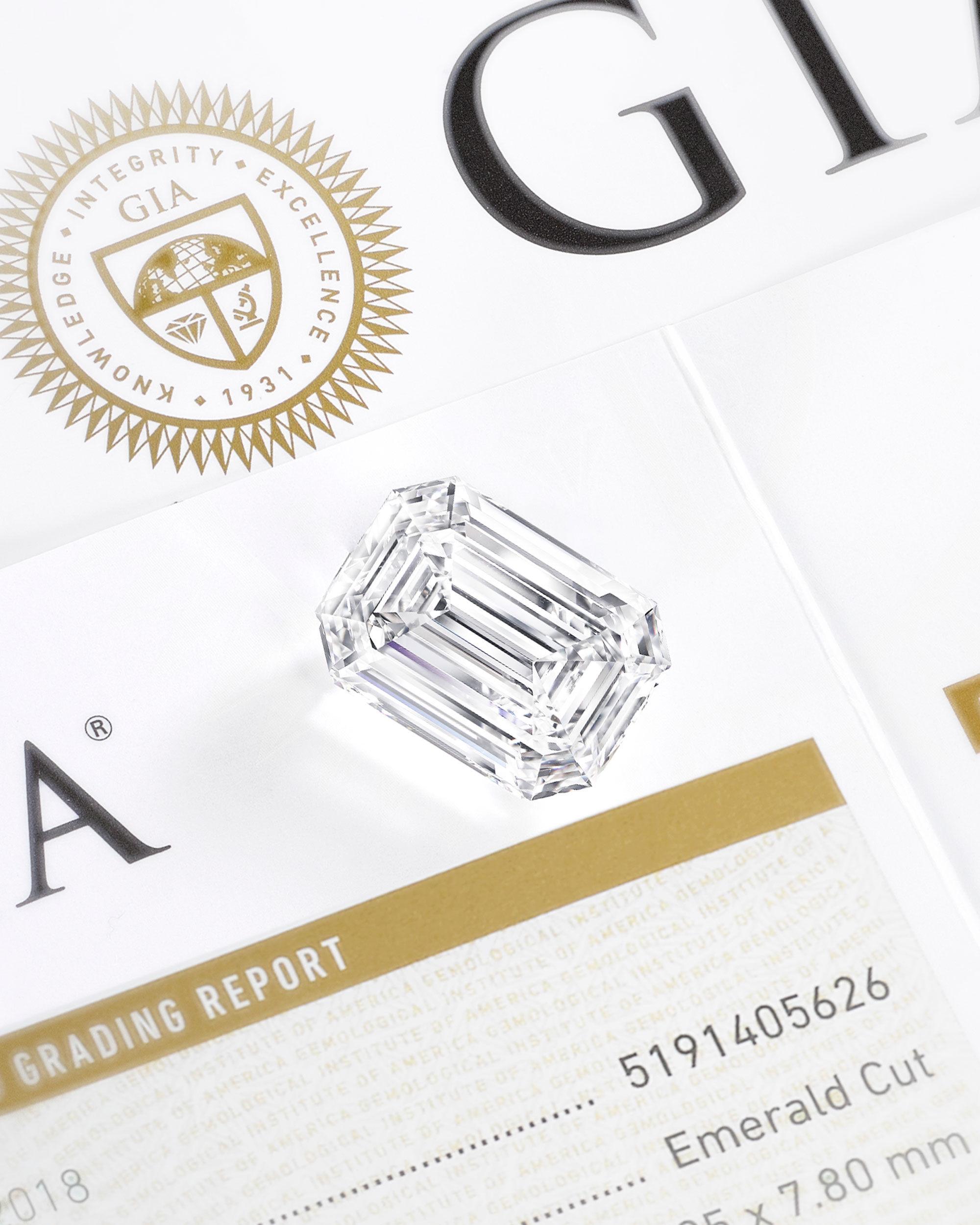 Close up of a Graff emerald cut diamond on a GIA certificate