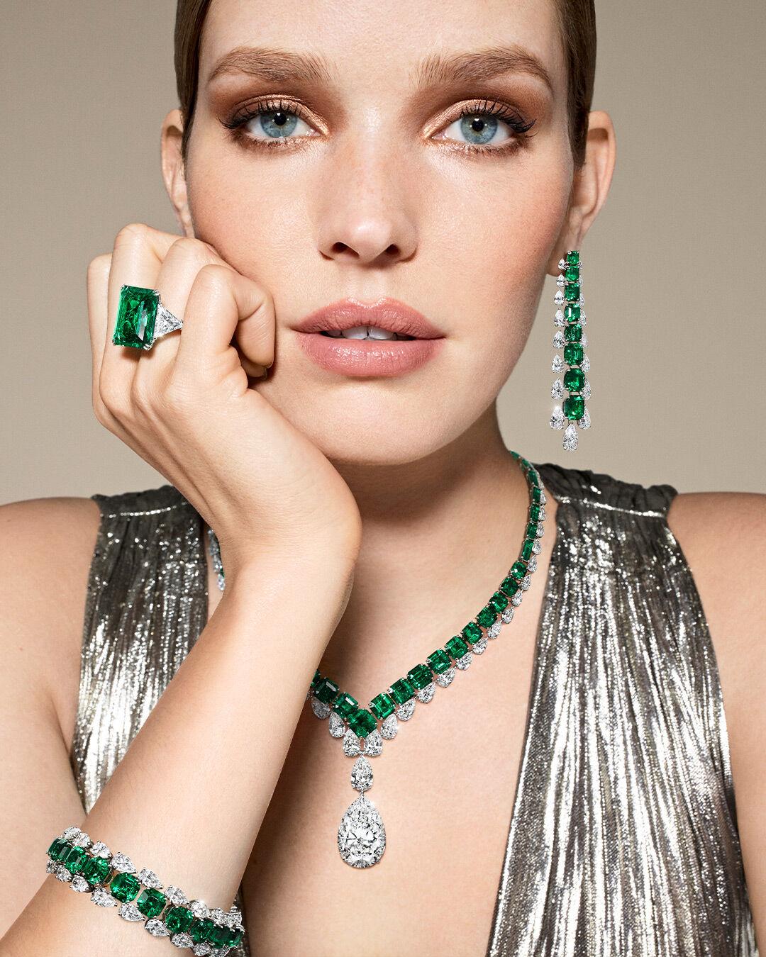 Model wears Graff emerald and white diamond high jewellery
