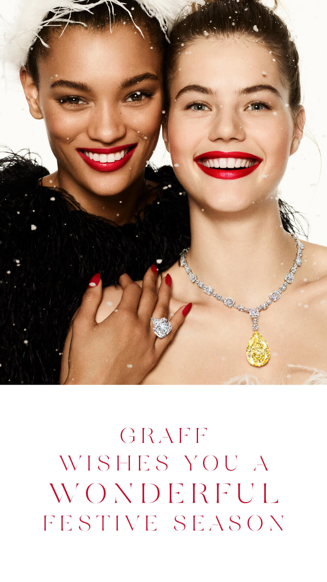 Two model wearing Graff diamond high jewellery with a 'Graff wishes you a wonderful festive season' quote