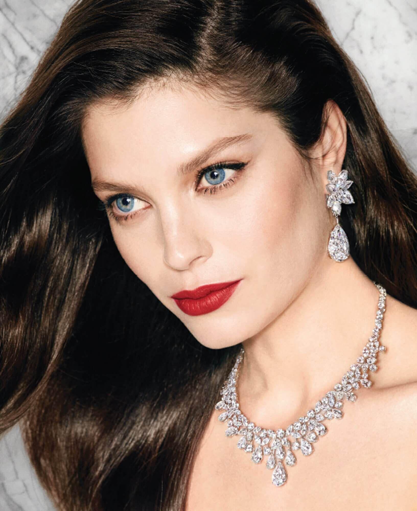 Model wears Graff Diamonds Diamond earrings featuring two 20 carat D Internally Flawless pear shape diamond drops