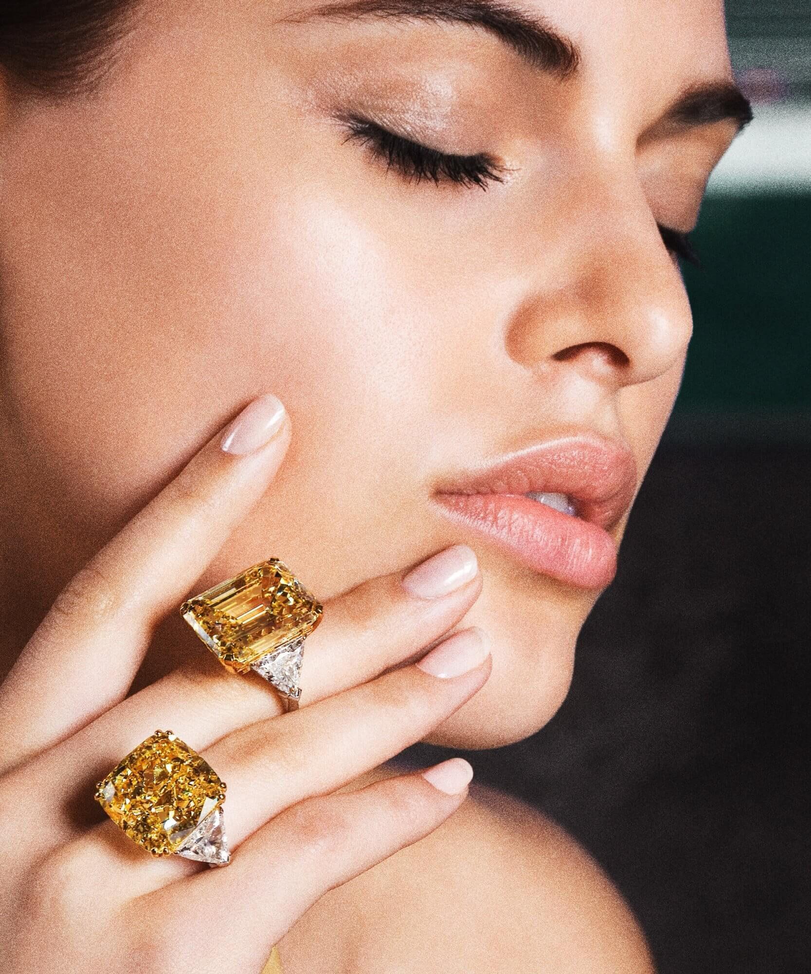 Model wears two yellow diamond rings by Graff