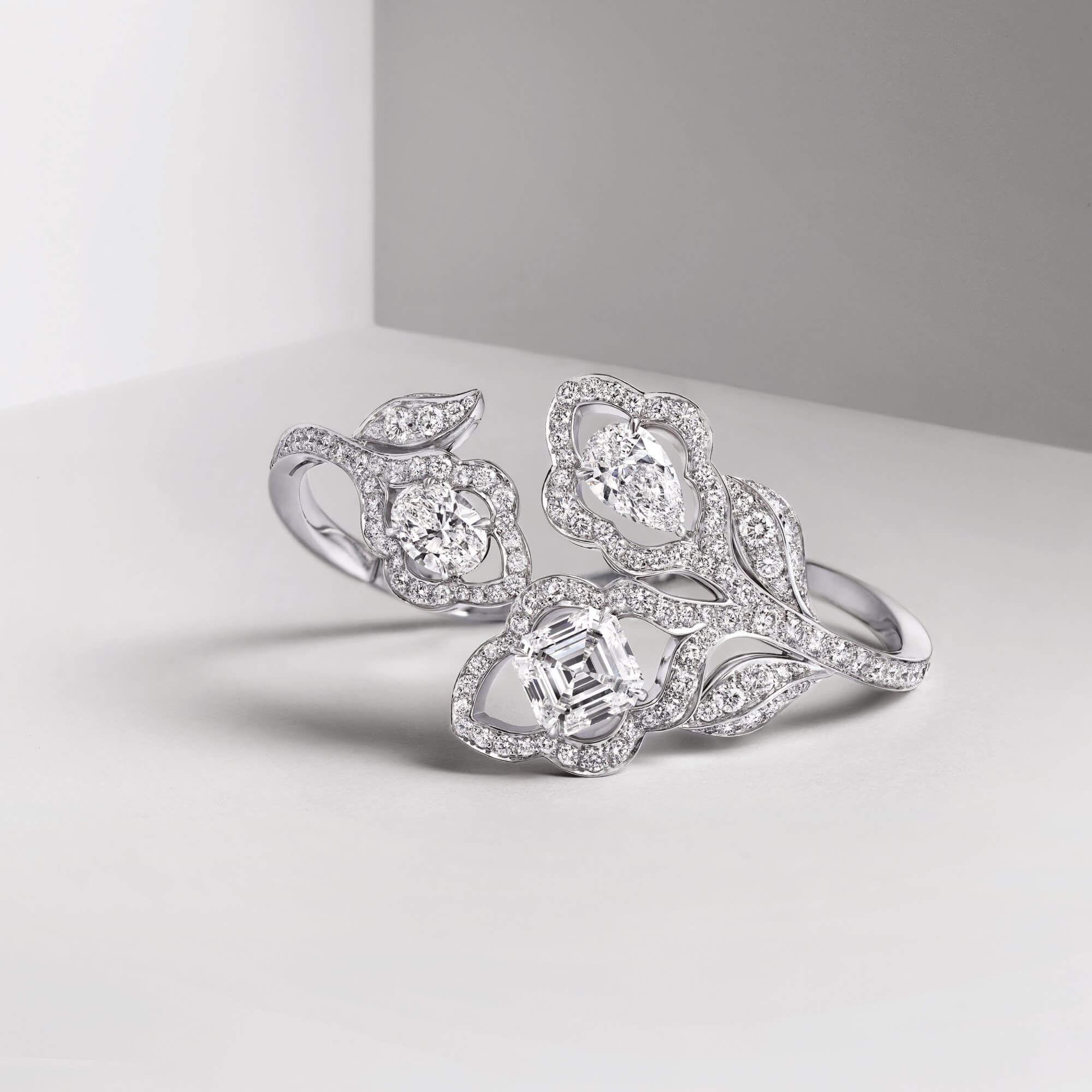 Graff diamond bracelet featuring a trio of pear shape oval and emerald cut diamonds