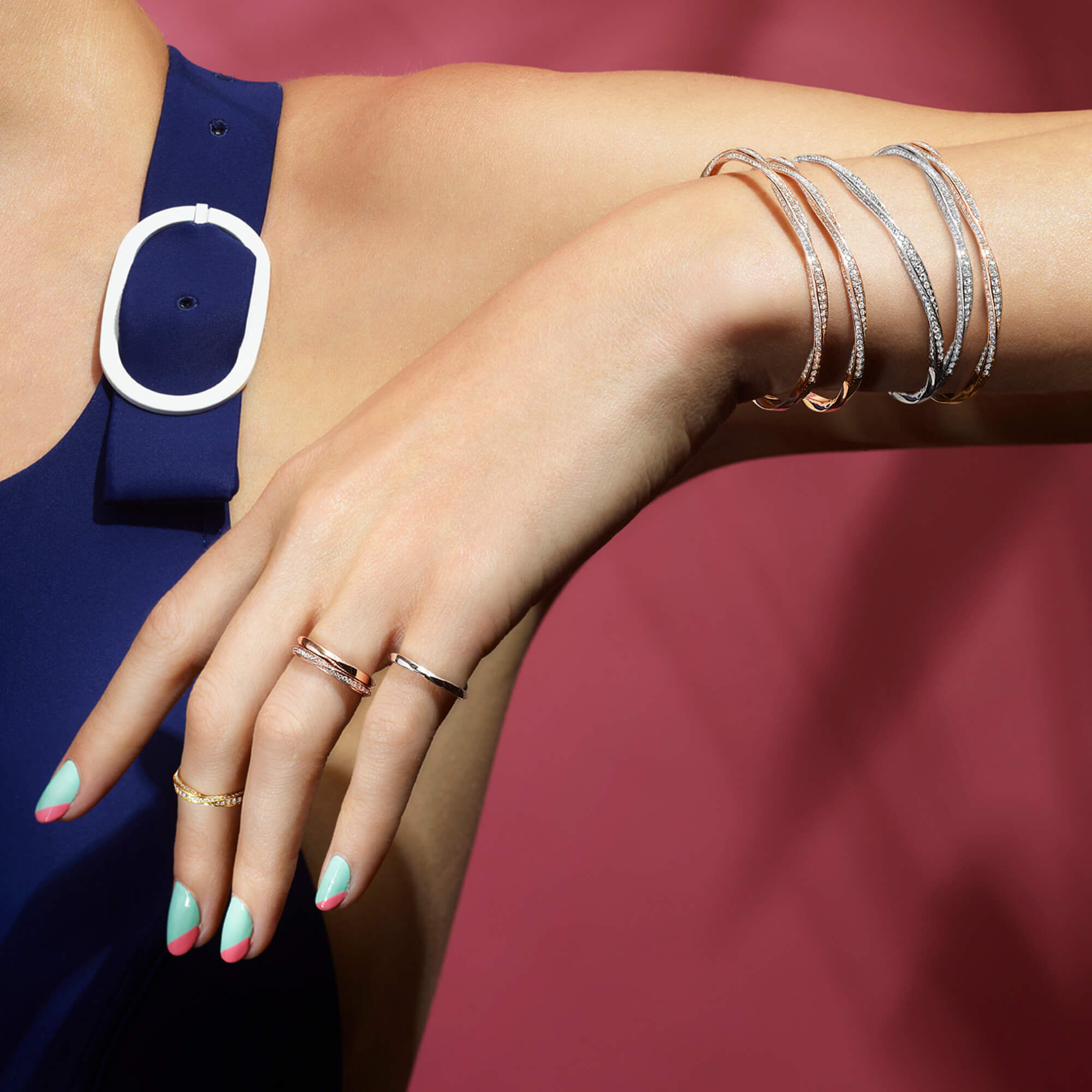 Close up of a model wearing Graff Spiral Jewellery Collection Rings and Bracelets