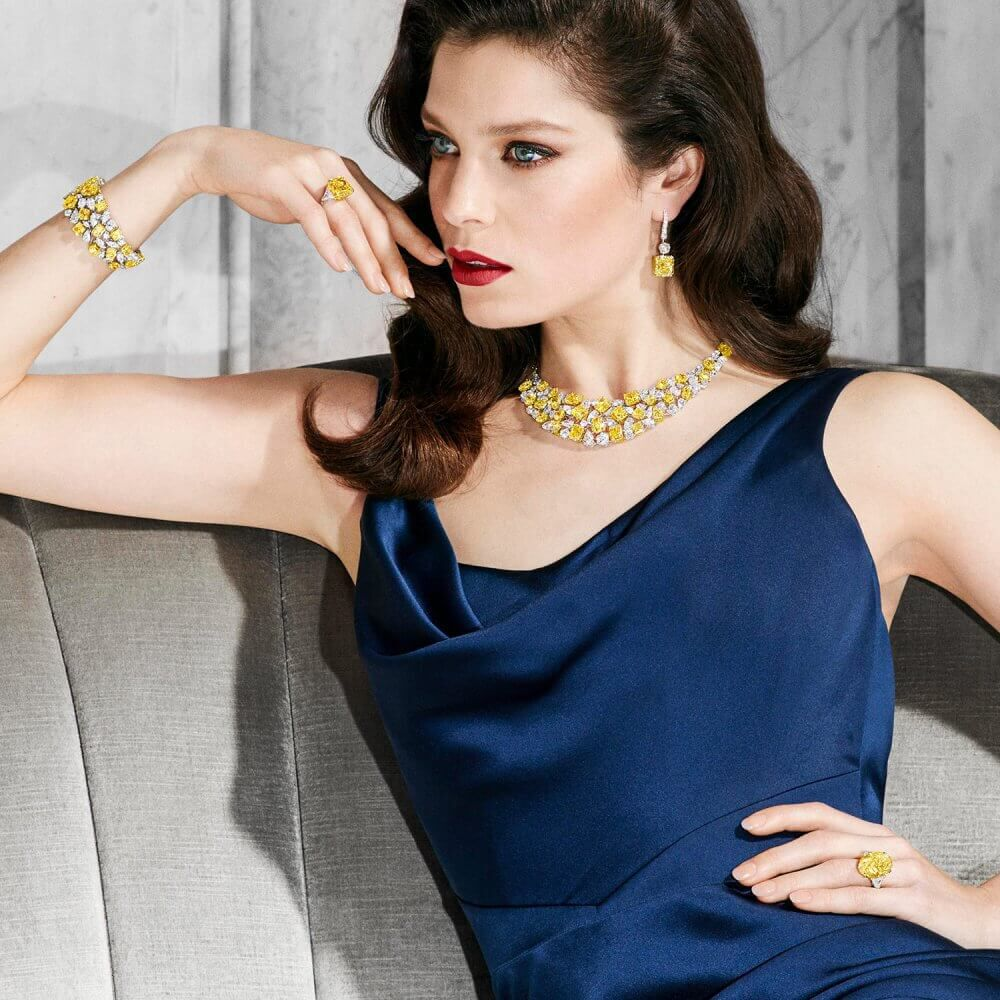 Model wears Graff yellow and white diamond high jewellery earrings, necklace, bracelet and ring