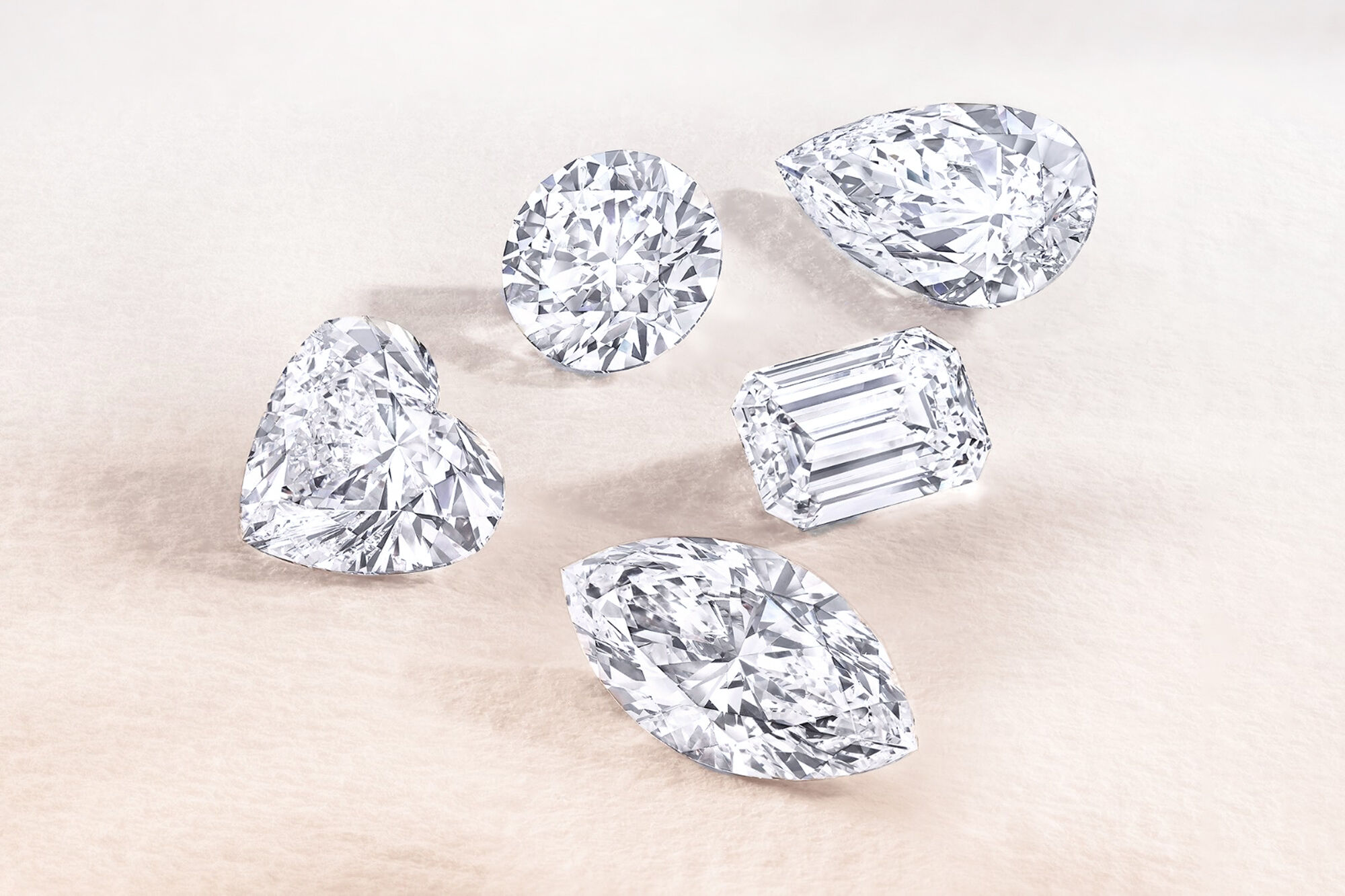 Close up of five white diamonds by Graff