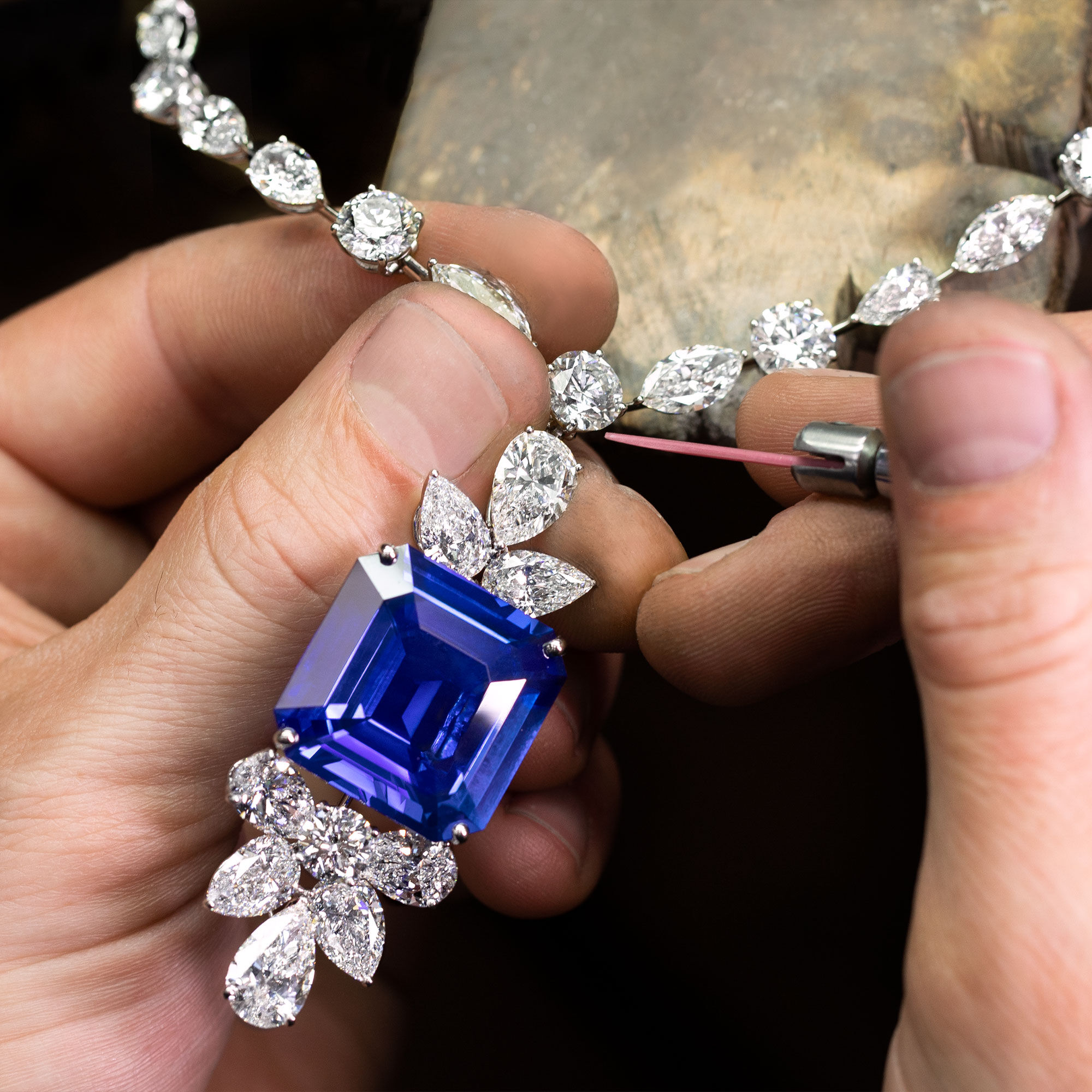 A Graff craftsman finalising a sapphire and diamond necklace in the workshop