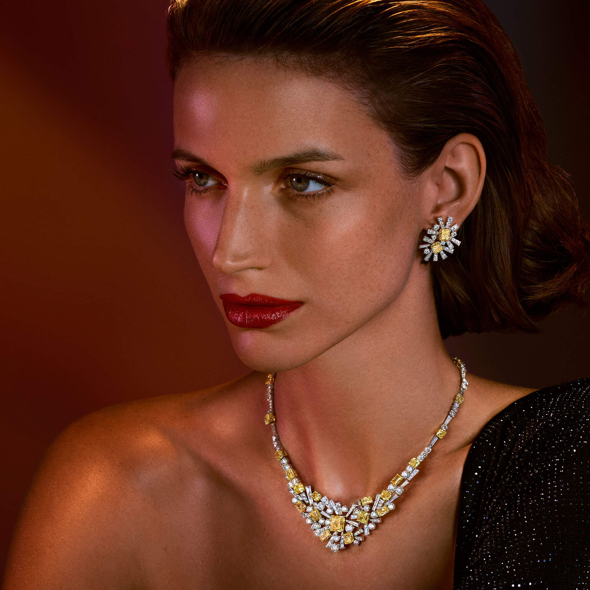 A model wears high jewellery Fancy Yellow and white diamond Threads necklace and earrings from the Graff high jewellery collection