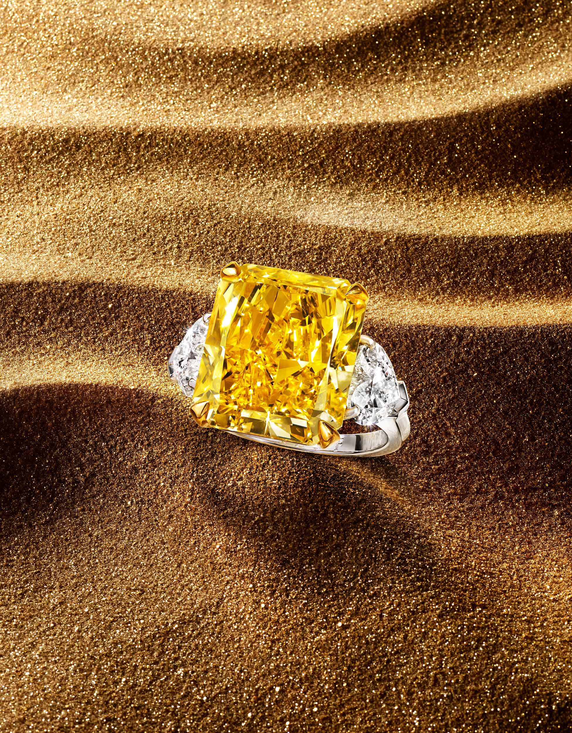 A Graff Yellow diamond unique solitaire high jewellery ring, on sands