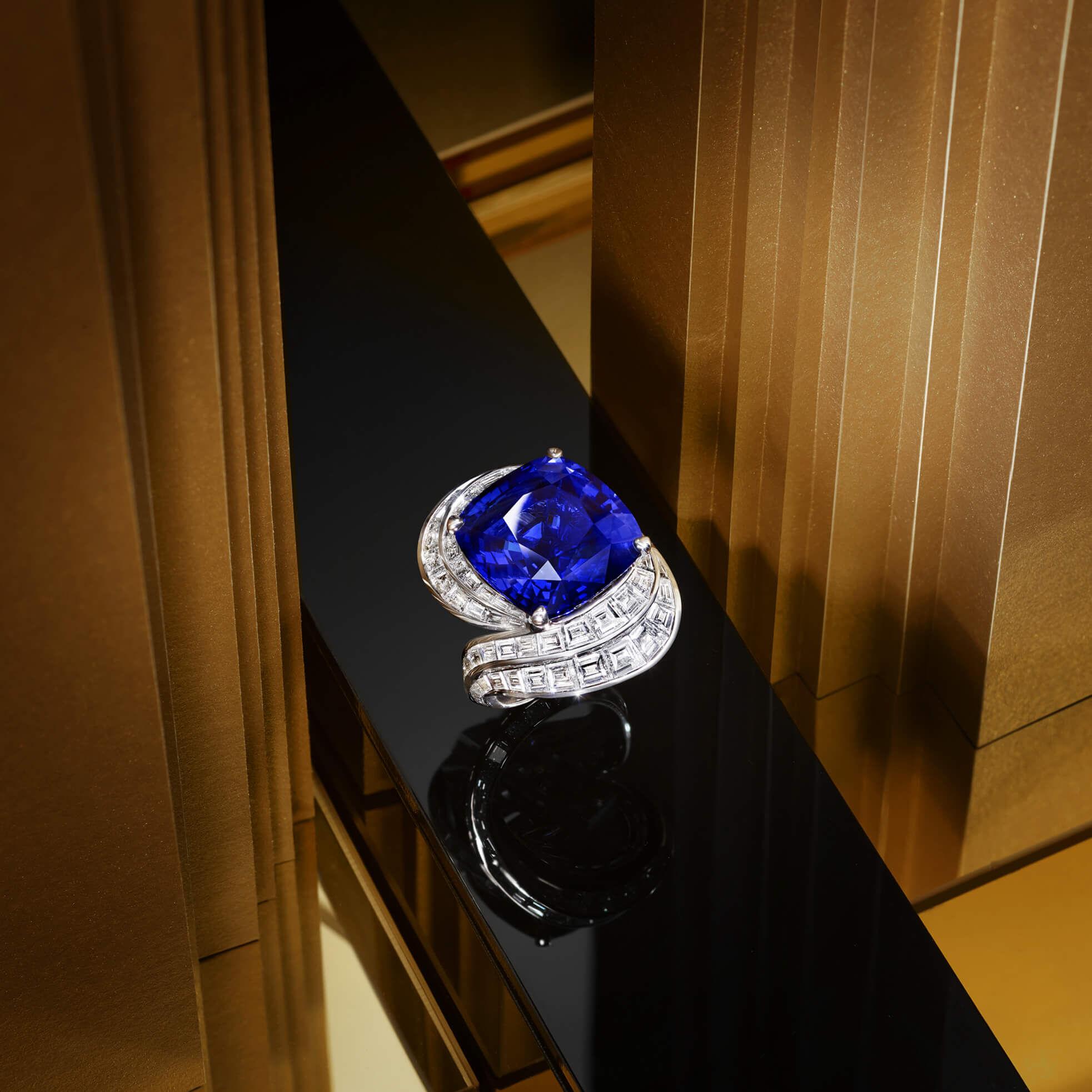 A Graff Sapphire and Diamond Ring featuring a 22.84 ct cushion cut sapphire.