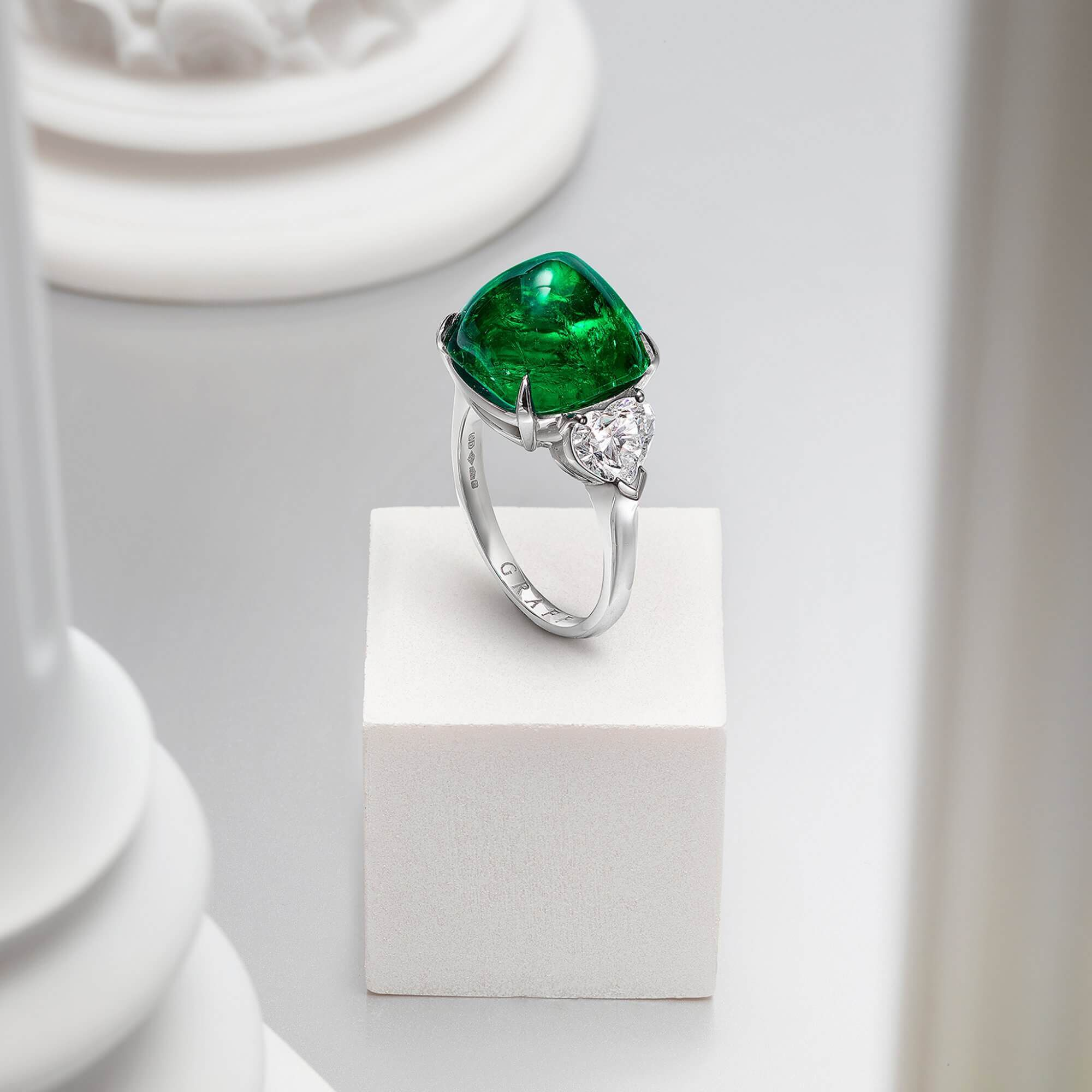 Graff Cabochon Emerald Promise High Jewellery Ring With White Heart Shape Diamond Shoulders inside a Gallery