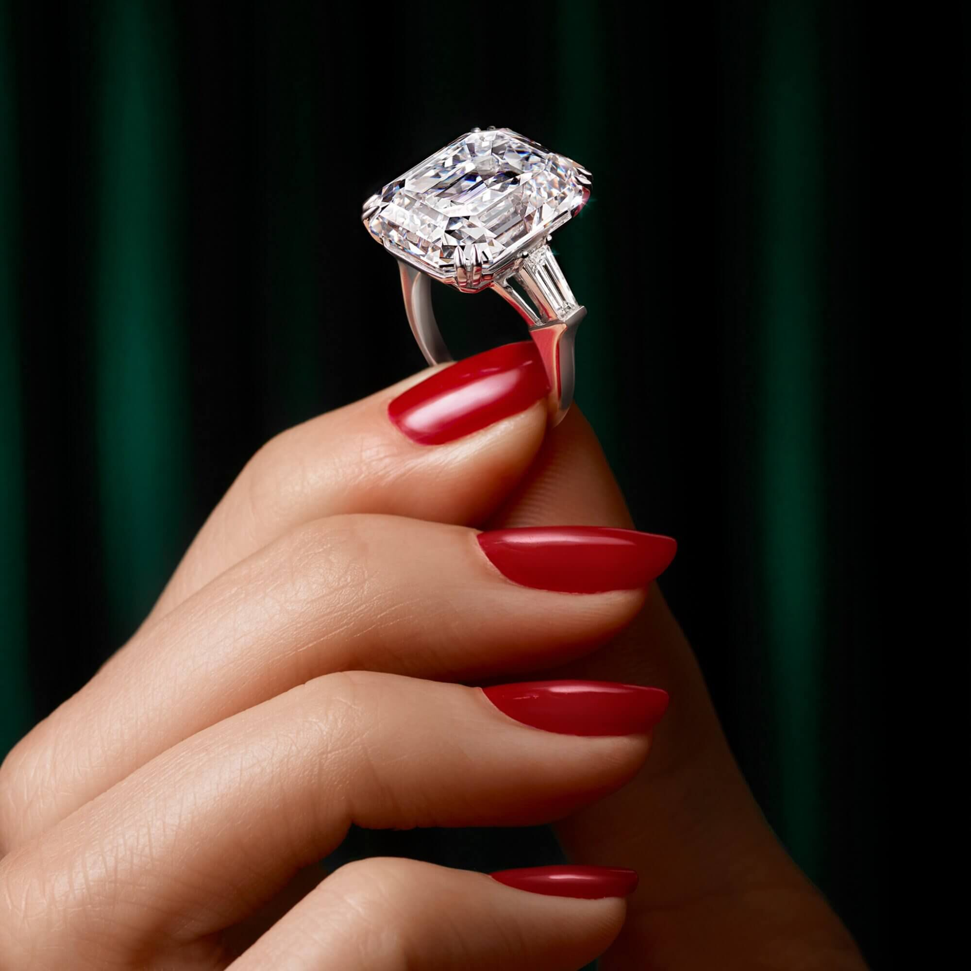 Model holding an emerald cut diamond ring from the Graff high jewellery collection