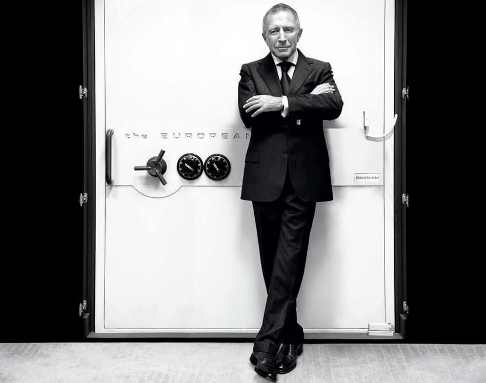 Mr Laurence Graff OBE stands in front of a jewellery vault