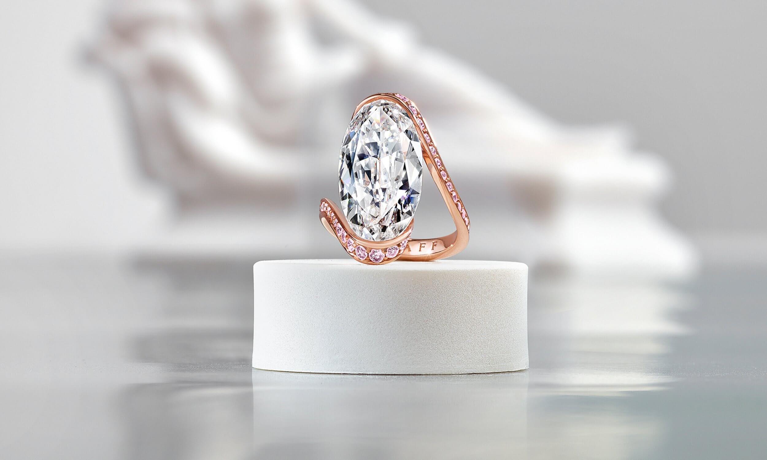 Graff D Internally Flawless White Oval Diamond High Jewellery Ring With Pink Pave Diamond Swirl Surround inside a Gallery