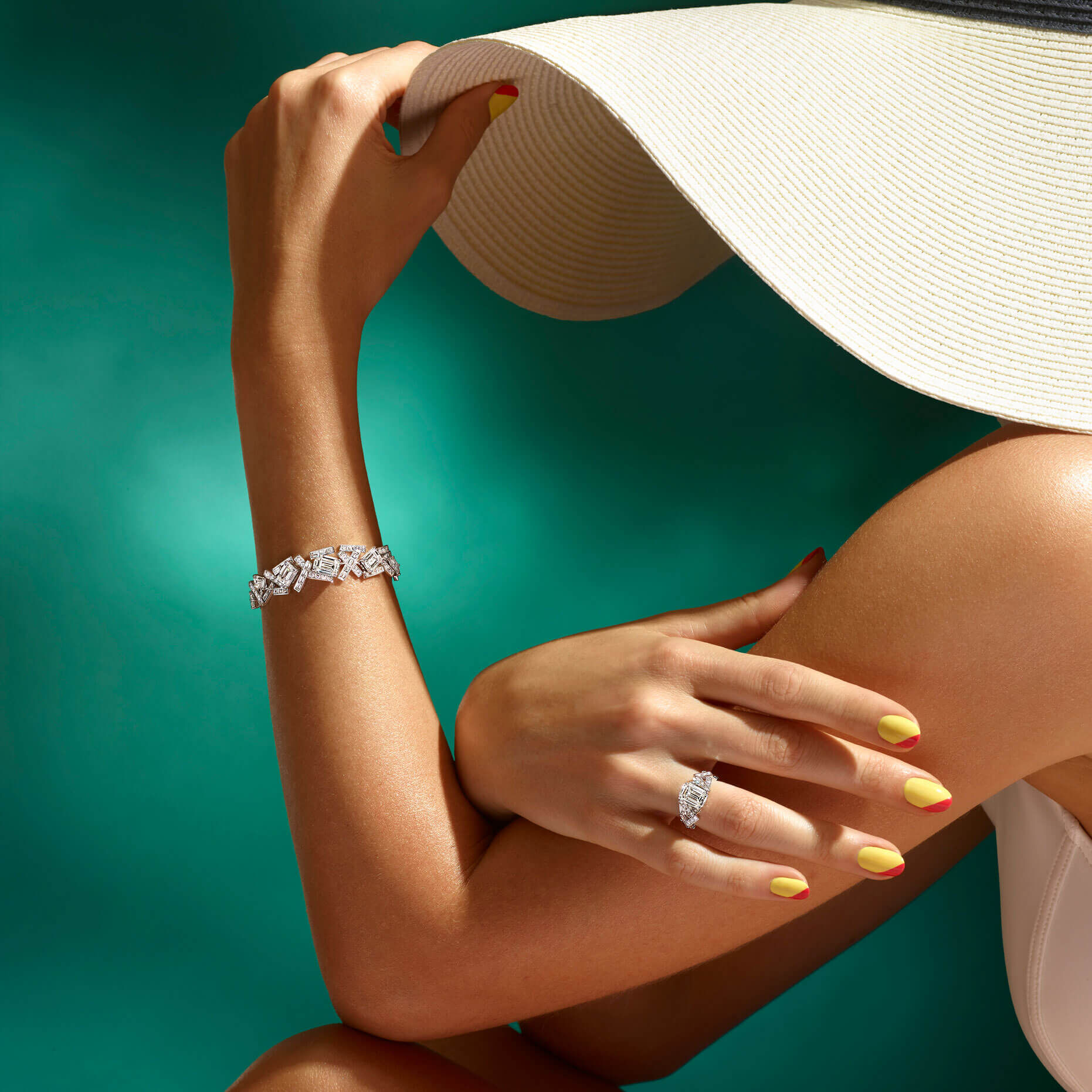 A model in summer outfit wearing Graff Threads Collection Diamond Ring and Bracelet