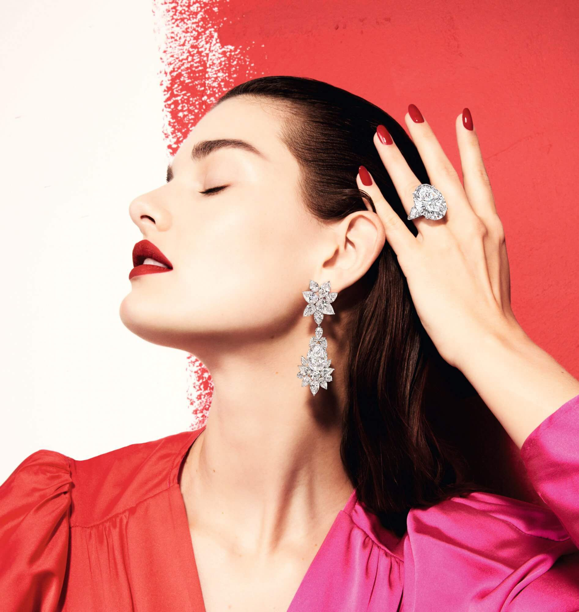 Model wears Graff white diamond high jewellery earrings and ring