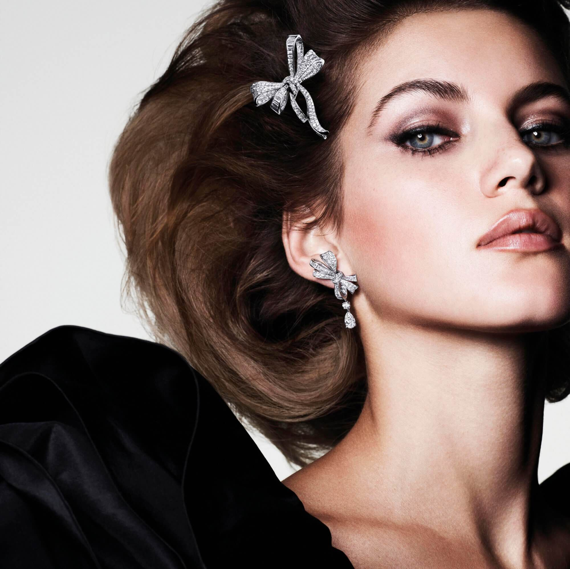 A model wearing Graff Bow collection Diamond brooch and earrings