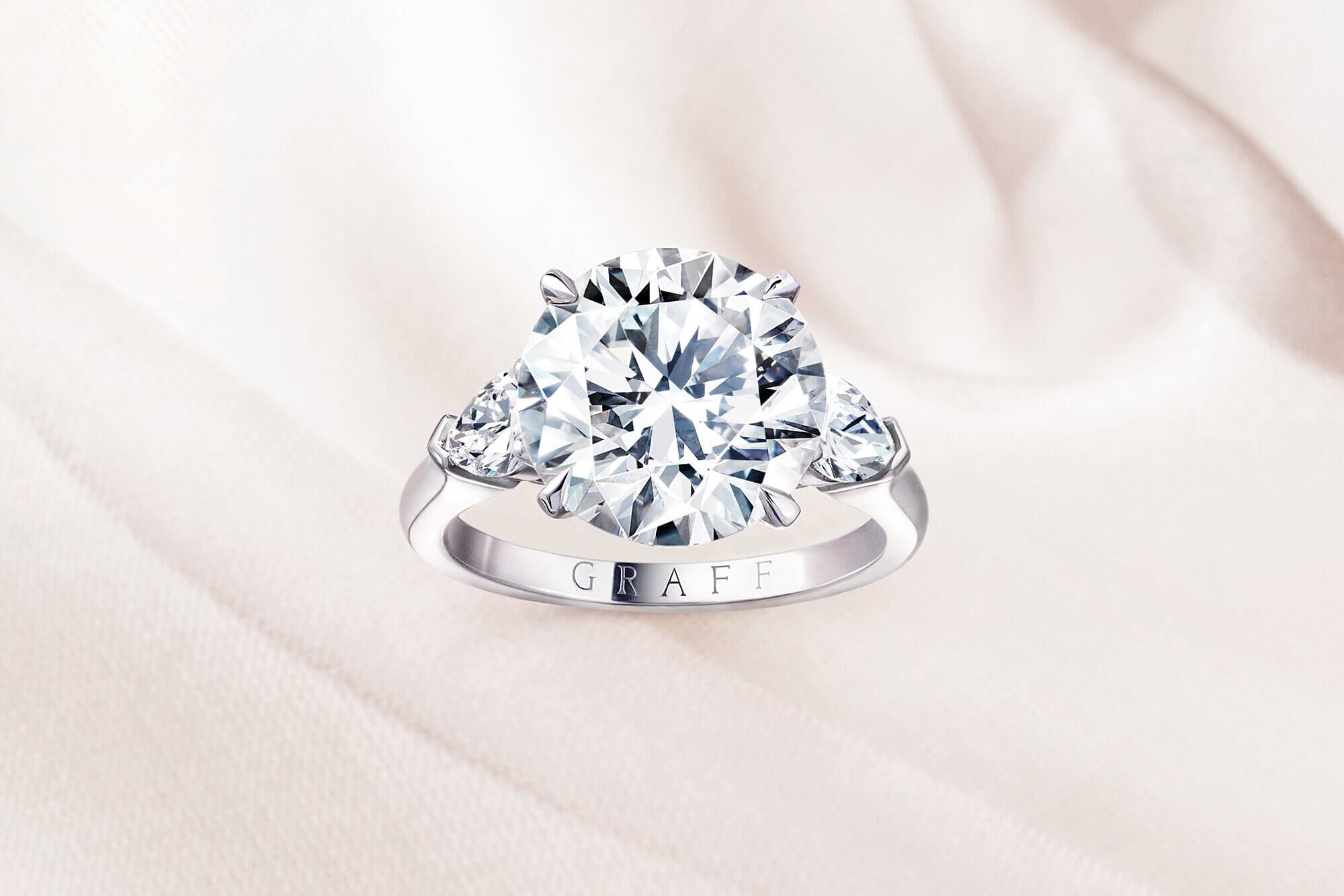 A Graff round diamond Promise setting engagement ring