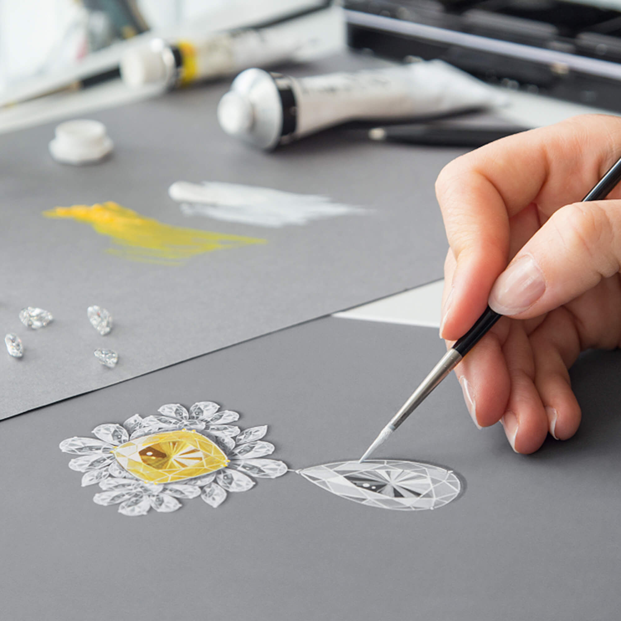 Designer drawing a high jewellery brooch