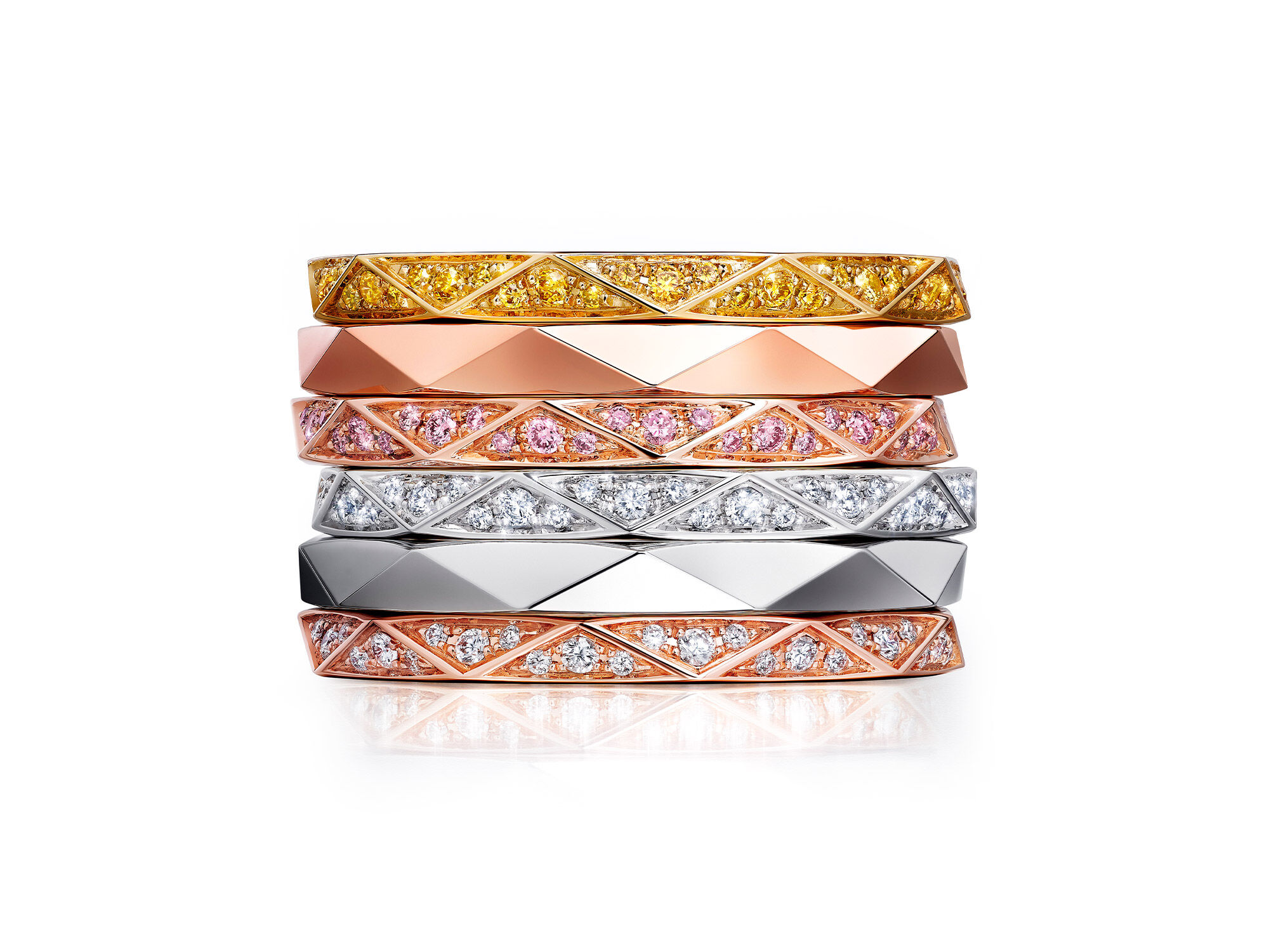 Stack of Laurence Graff Signature collection bands in yellow, rose and white gold