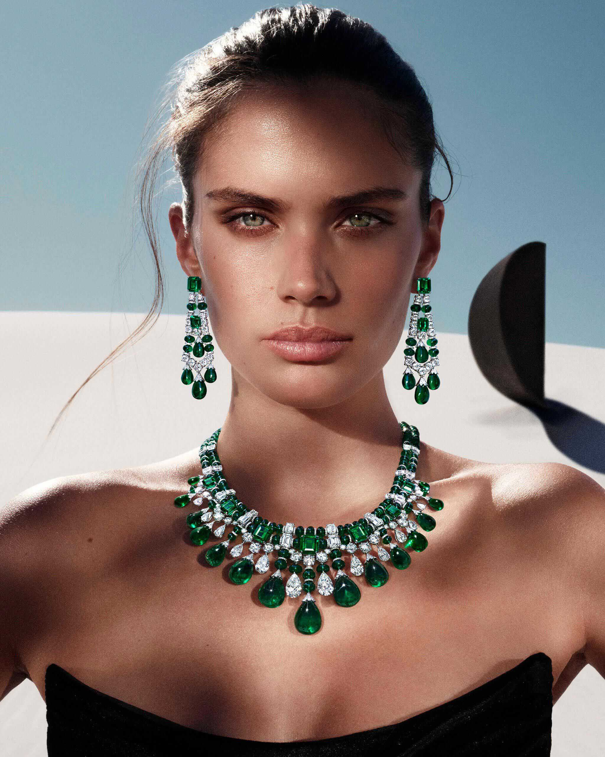 Model wears the Graff Tribal collection emerald and diamond diamond high jewellery earrings and necklace