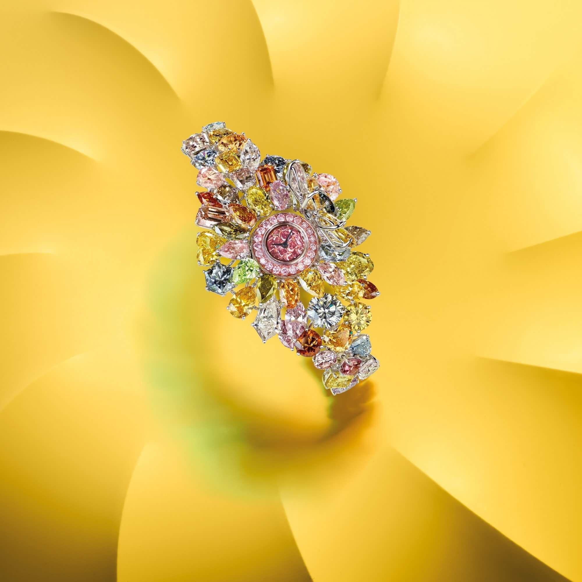 A Graff Multi coloured diamond secret watch totalling 90 cts