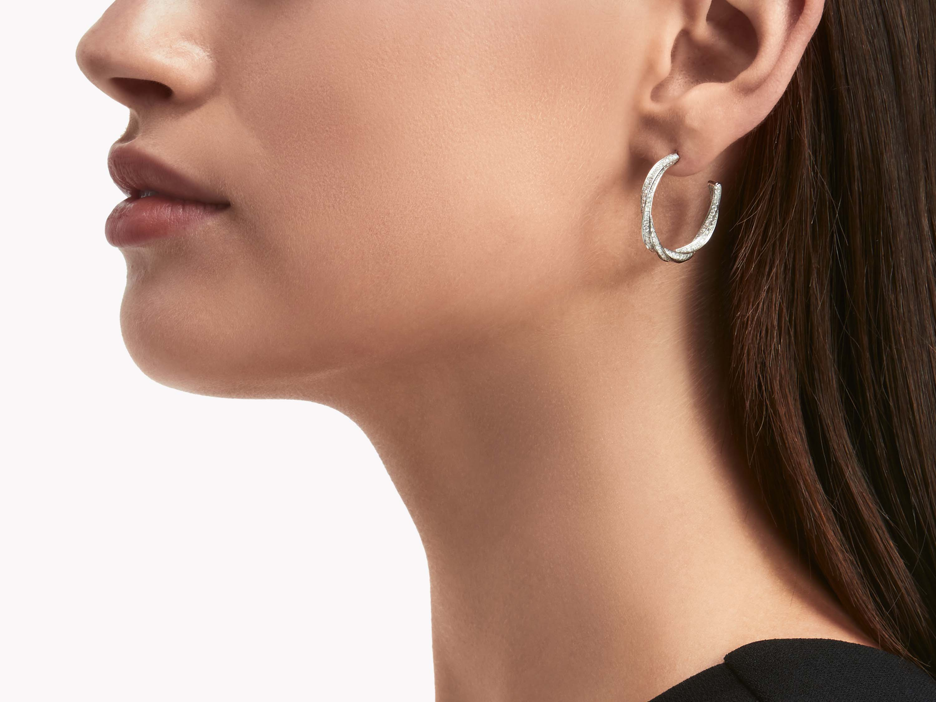 Model wearing Graff Spiral Diamond Hoop Earrings WHITE GOLD