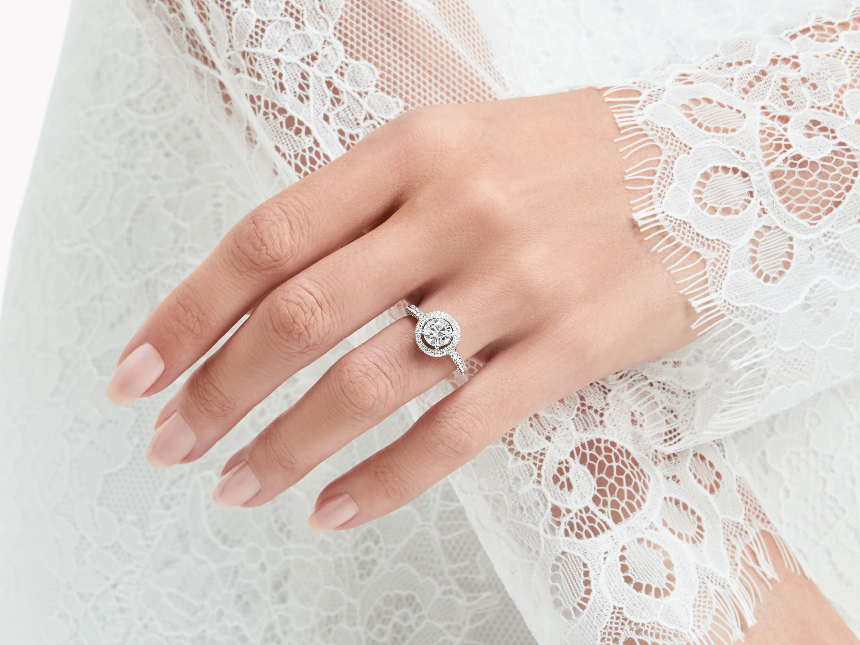 Model wears Constellation Round Diamond Engagement Ring from the Graff bridal jewellery collection