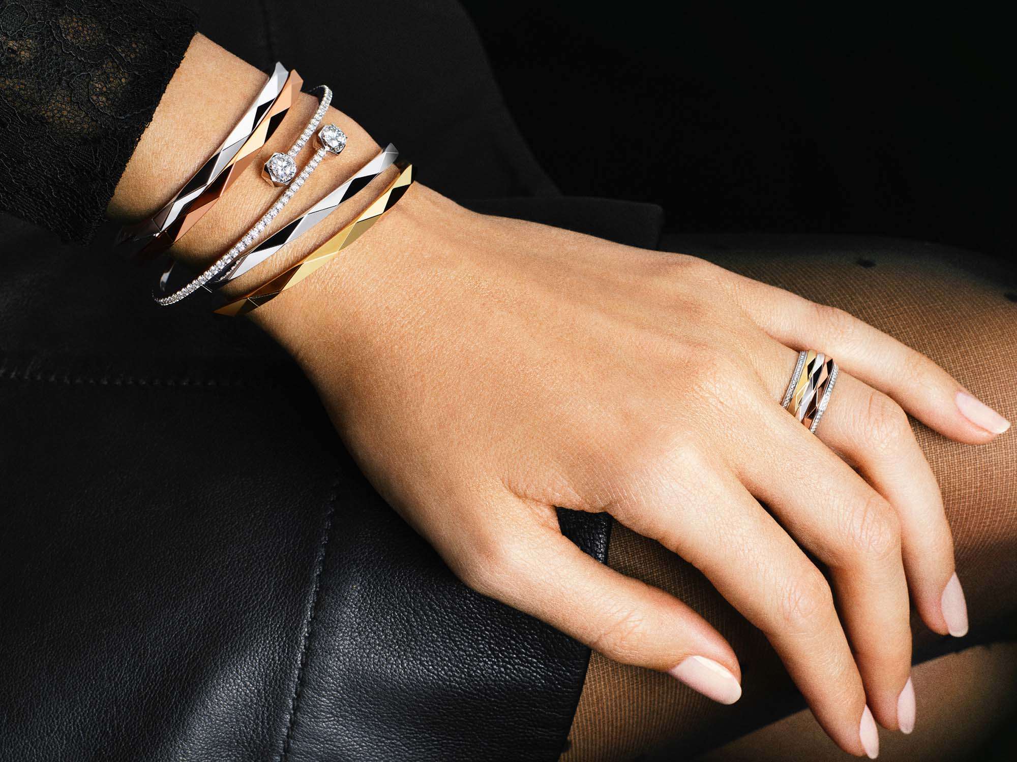 Model wears Laurence Graff Signature jewellery collection Wraparound Diamond Bangle and Laurence Graff Signature Triple Spinning Diamond Band