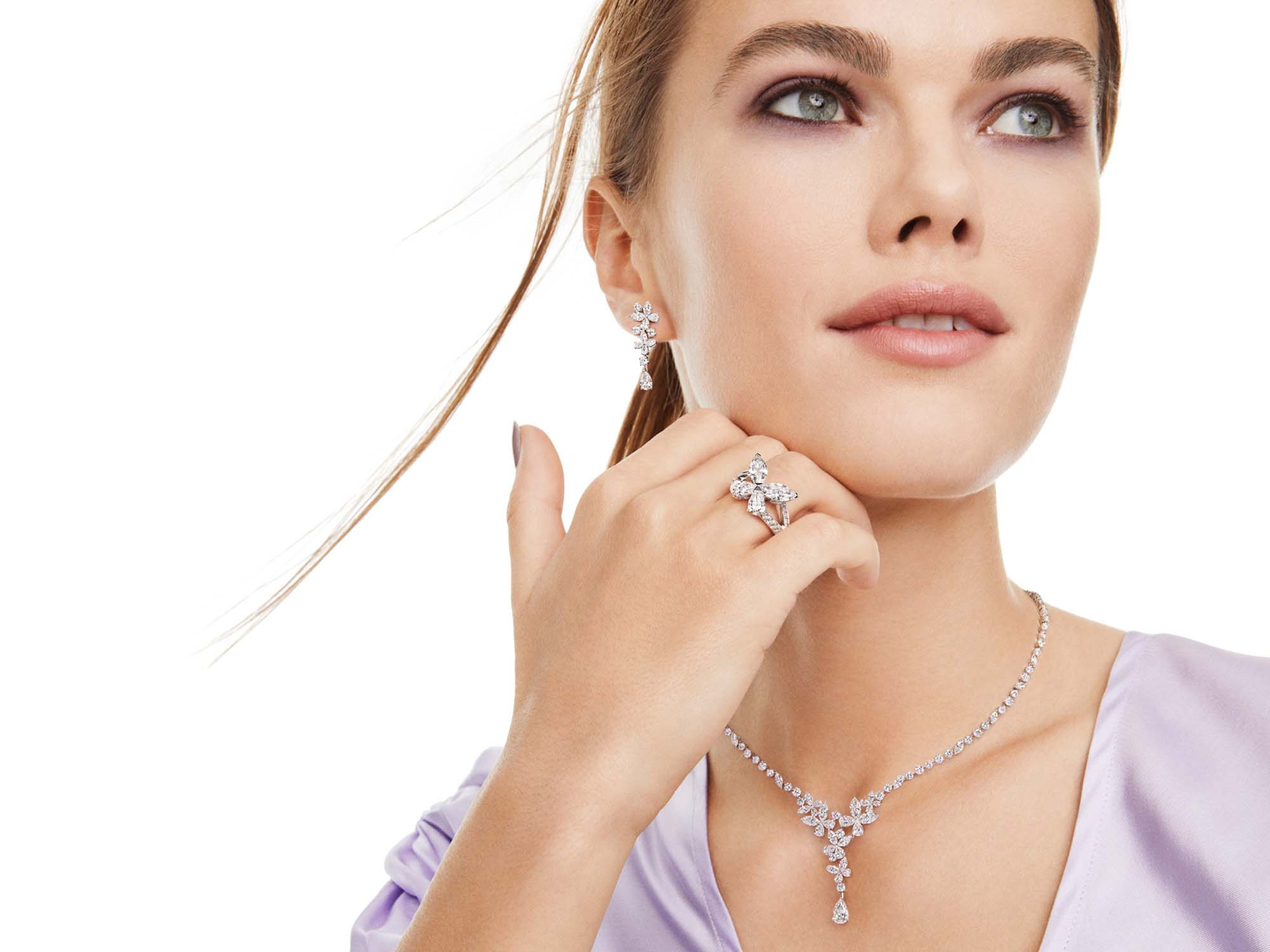 Model wearing Graff Classic Butterfly Diamond Ring, Classic Butterfly Diamond Drop Earrings and Classic Butterfly Diamond Necklace from the Graff jewellery collection