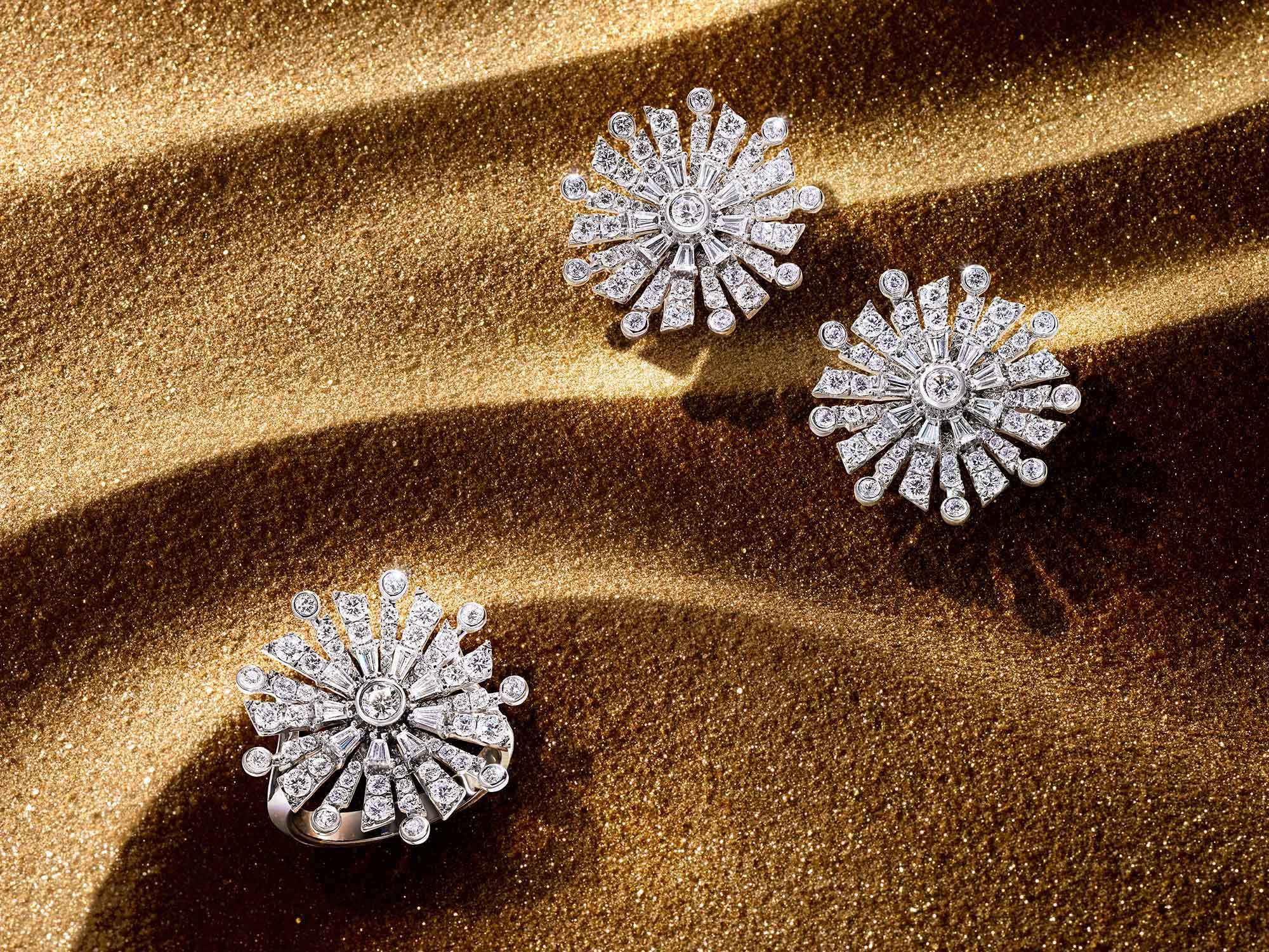 The Graff New Dawn diamond earrings and ring from the Tribal jewellery collection, on sand