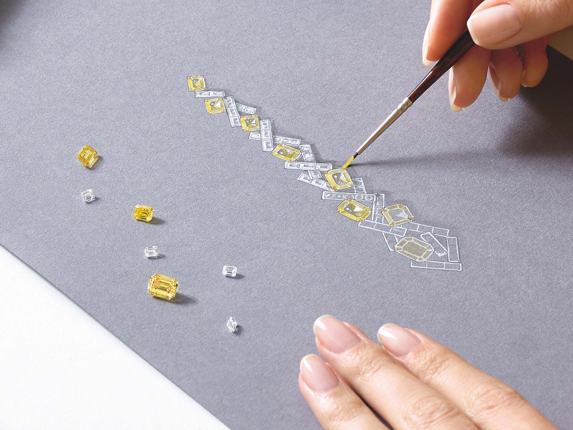 Graff Designer sketching high jewellery Earrings made of yellow diamonds and diamonds.