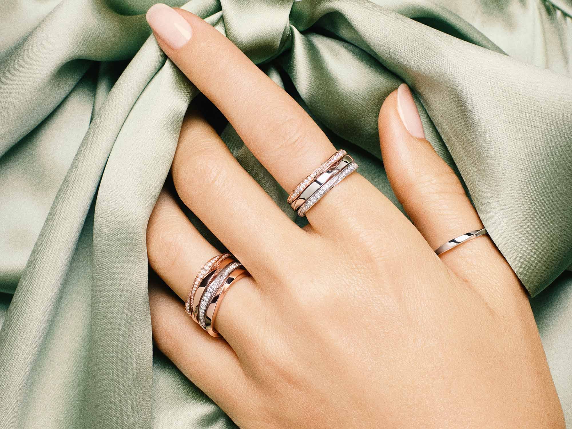 Model's hand with Spiral Pavé Diamond Band and Spiral Band from the Graff Spiral Jewellery Collection