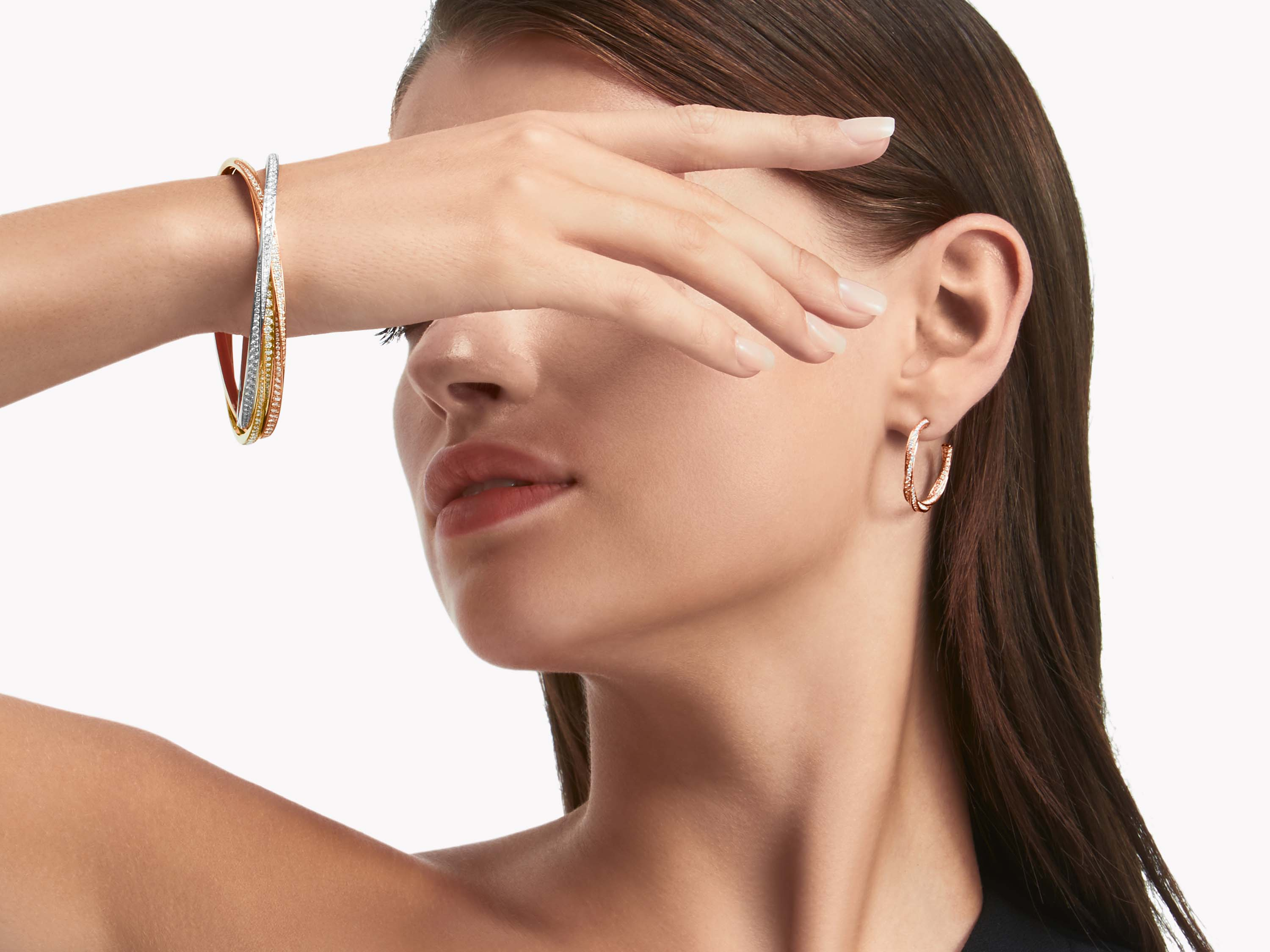 Model wearing Triple Spiral Pavé Diamond Bangle WHITE, YELLOW AND ROSE GOLD and Graff Spiral Diamond Hoop Earrings ROSE GOLD