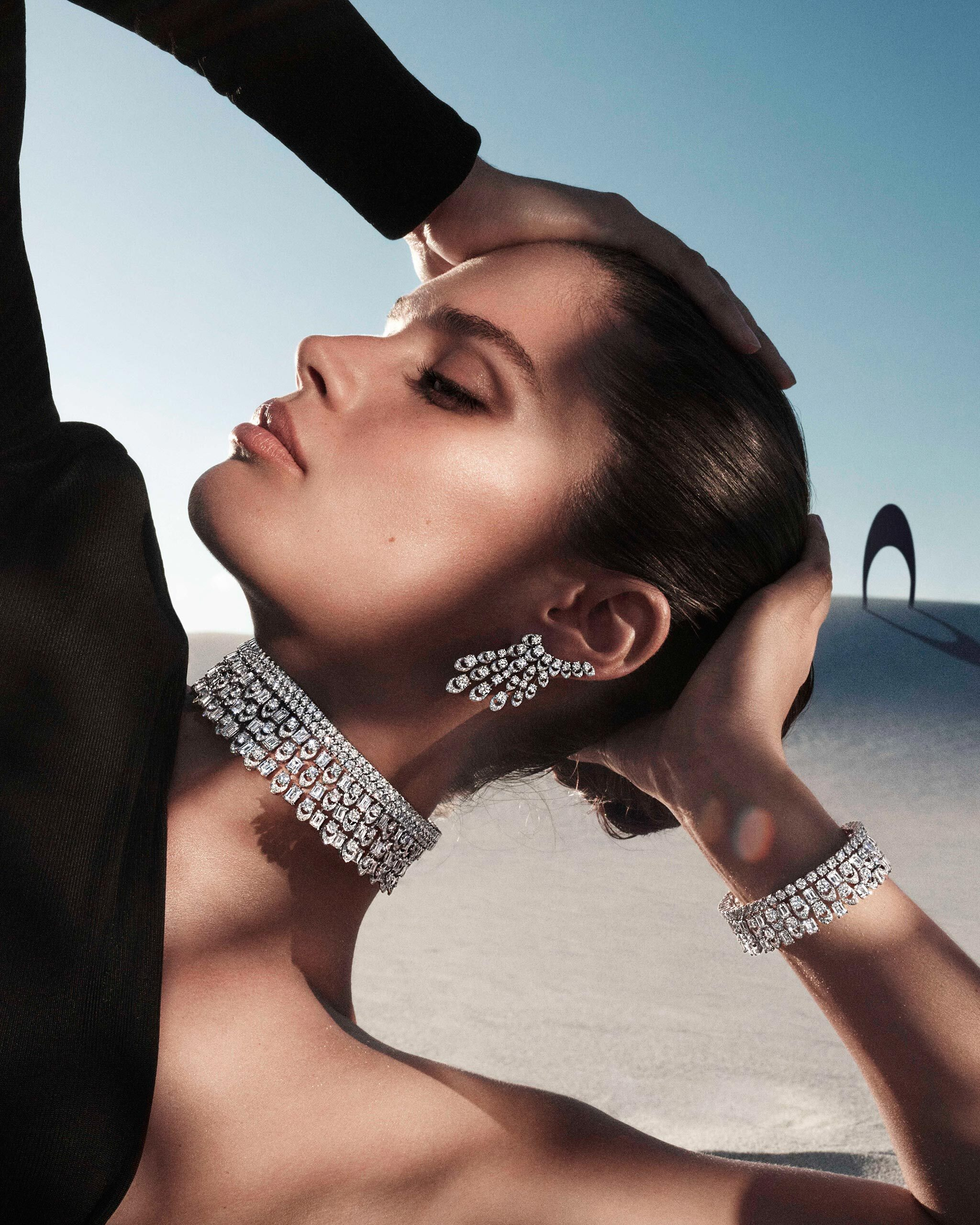 Model wears Graff Gateway diamond jewels from the Tribal collection, in a desert