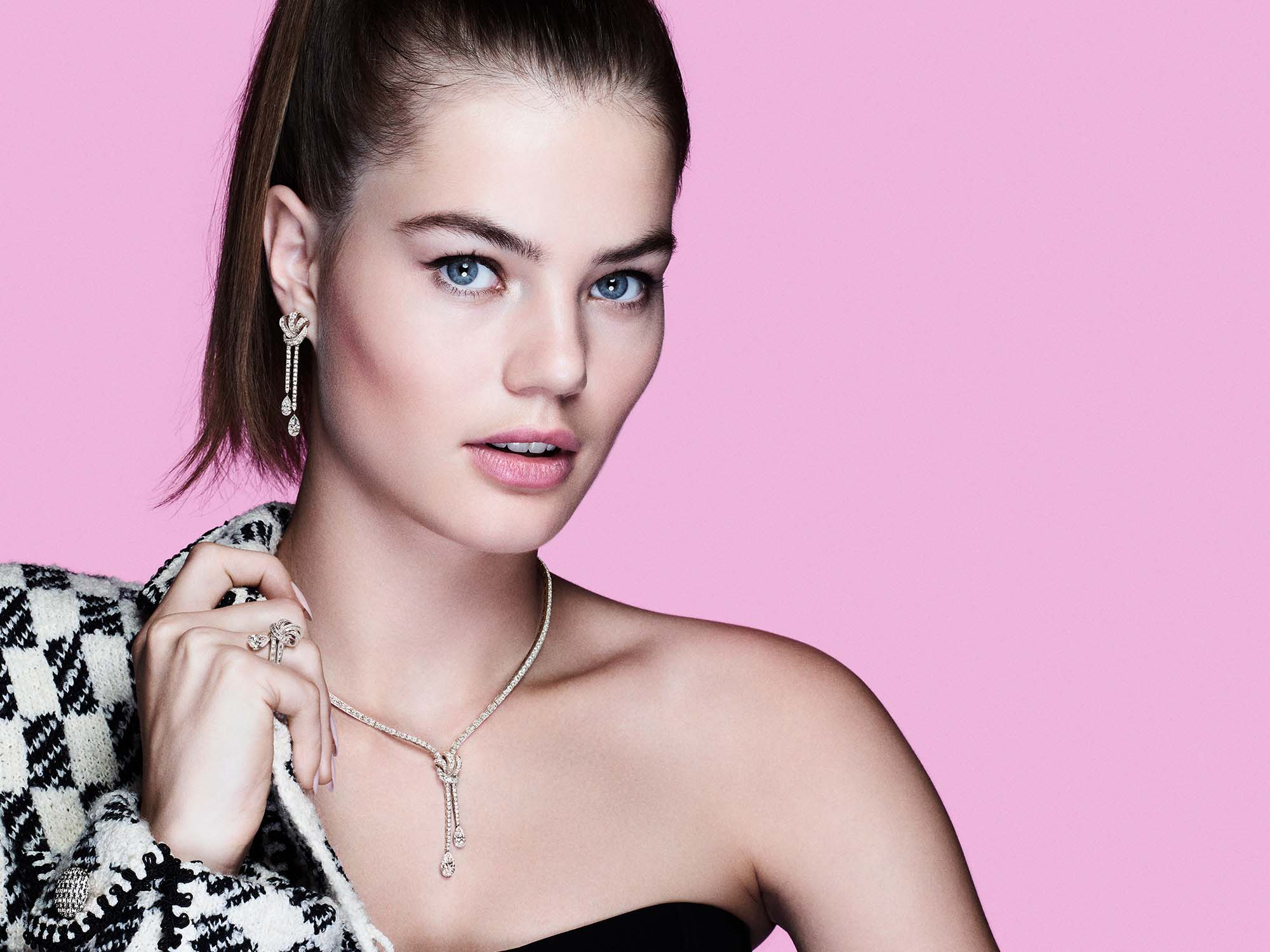 Model wearing Graff Tilda's Bow jewellery collection diamond ring, earrings and necklace