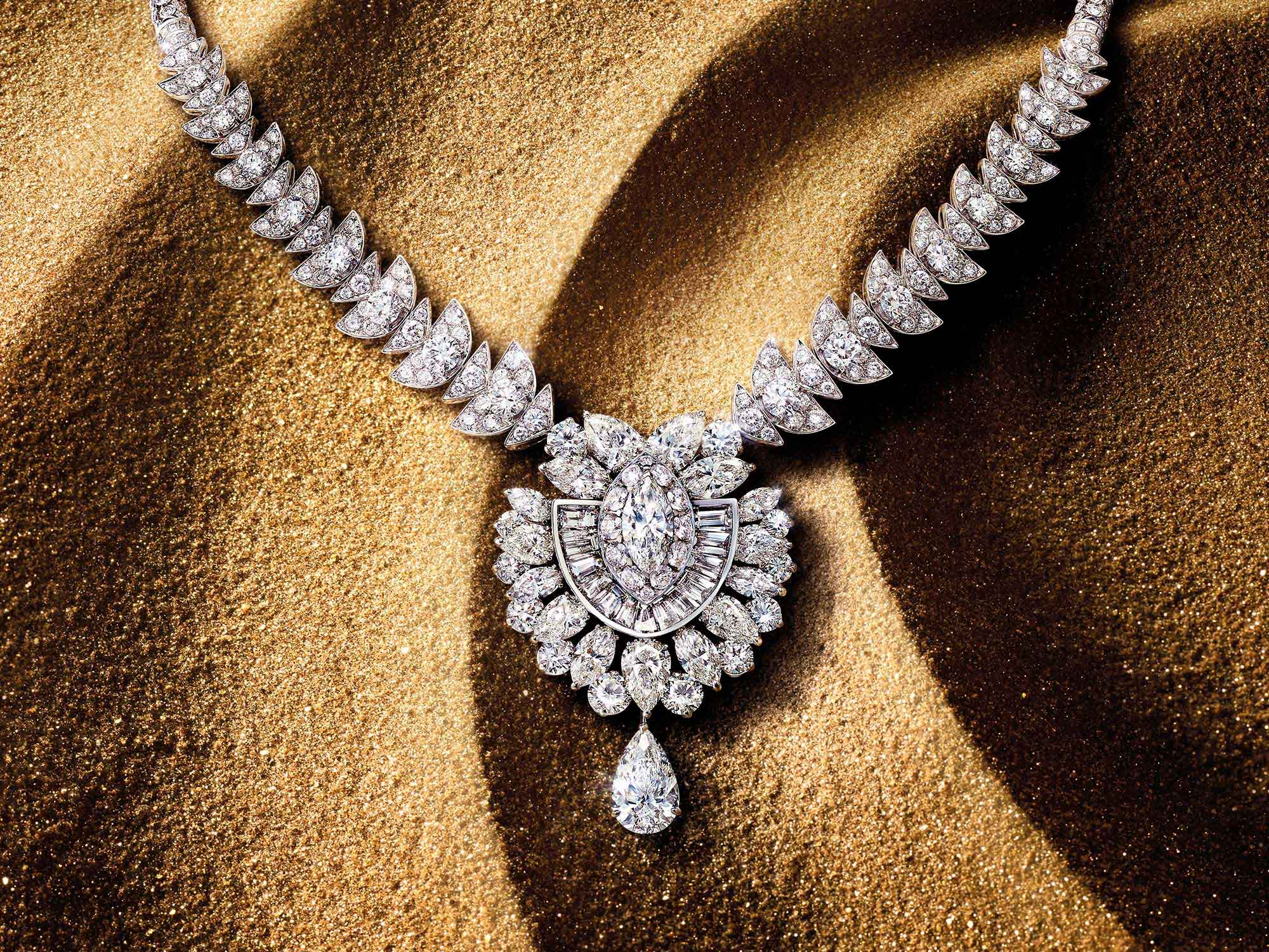 The Graff Night Moon diamond high jewellery necklace from the Tribal jewellery collection, on sand