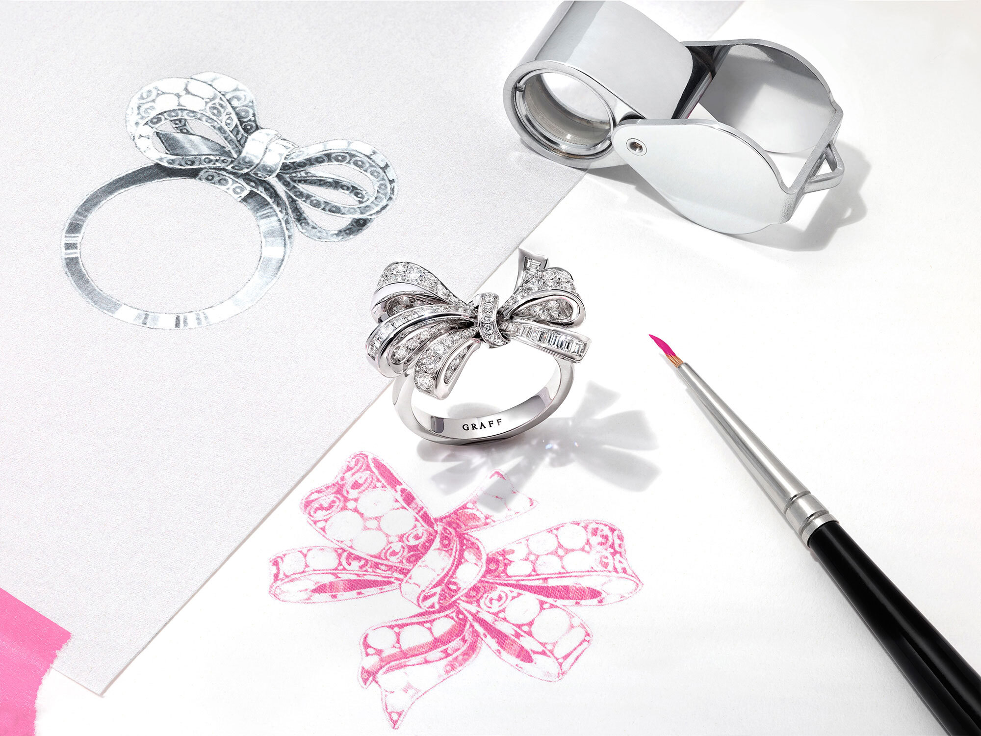 A Graff Tilda's Bow jewellery collection diamond ring with sketches of the design