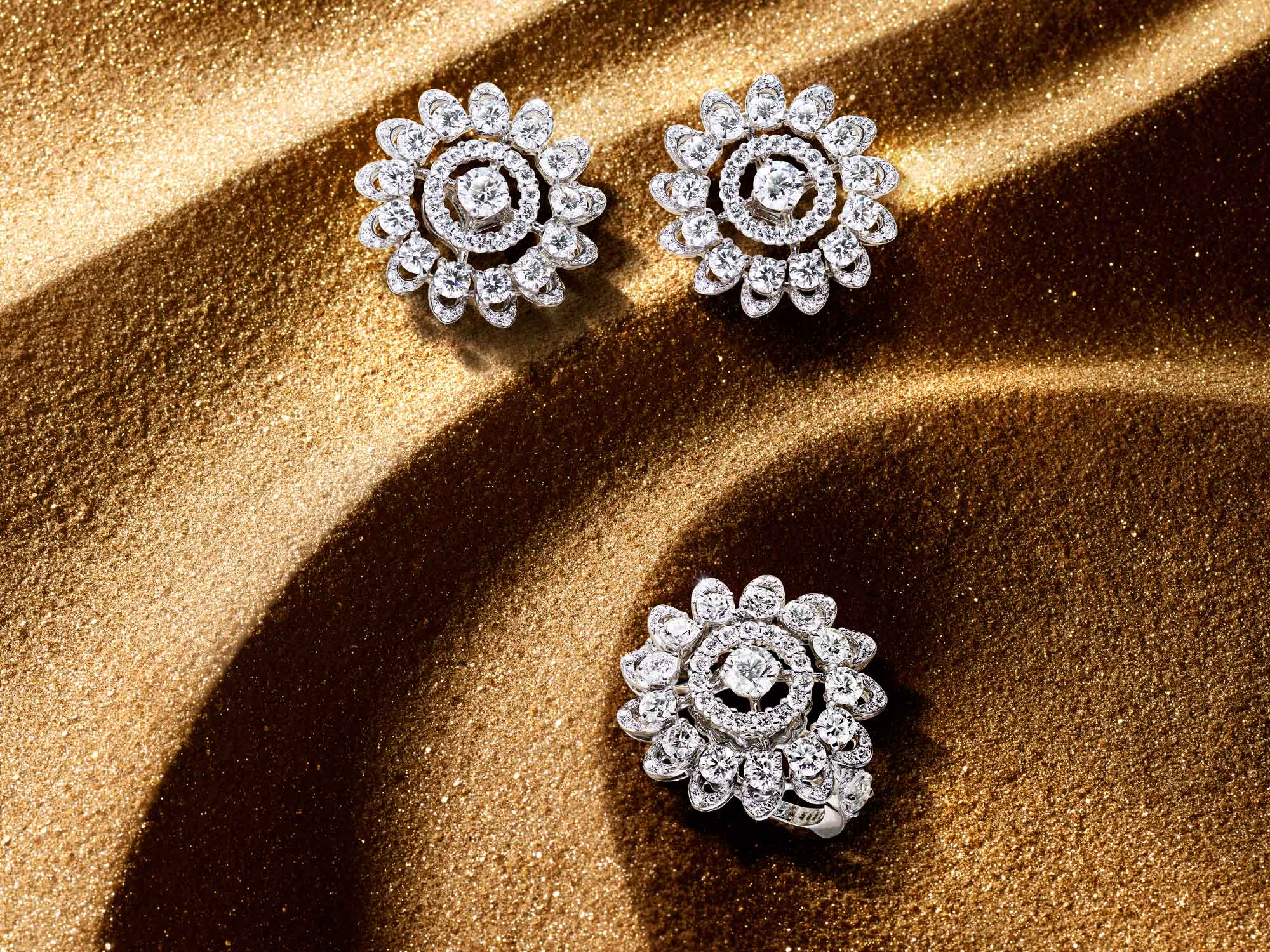 The Graff Gateway diamond earrings and ring from the Tribal jewellery collection, on sand